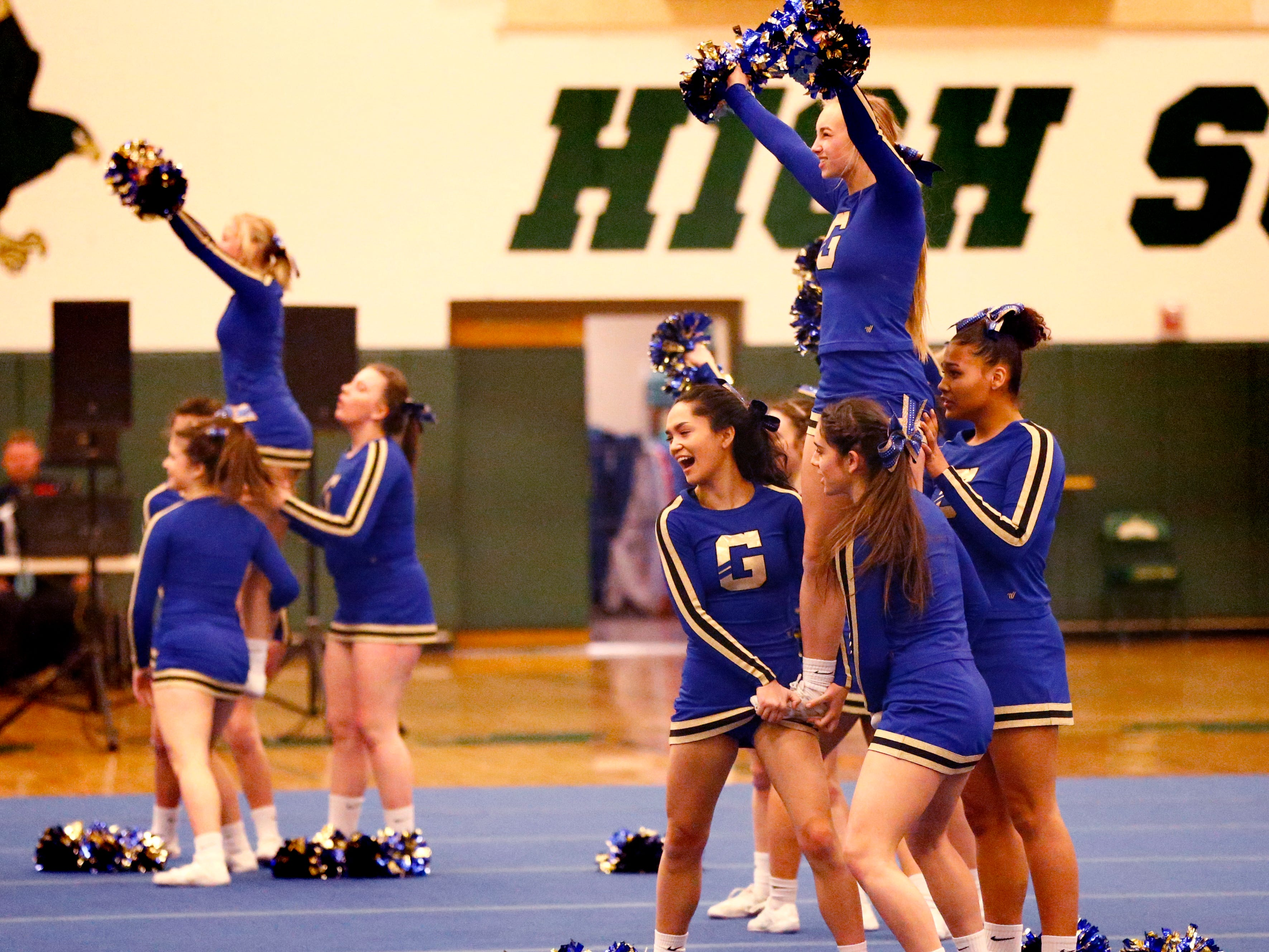The Germantown High School team performs stacks while competing in the cheer dance division during the Greenfield Xtreme Cheer competition at Greenfield High School on Jan. 12 that drew 56 teams competing in 13 divisions.