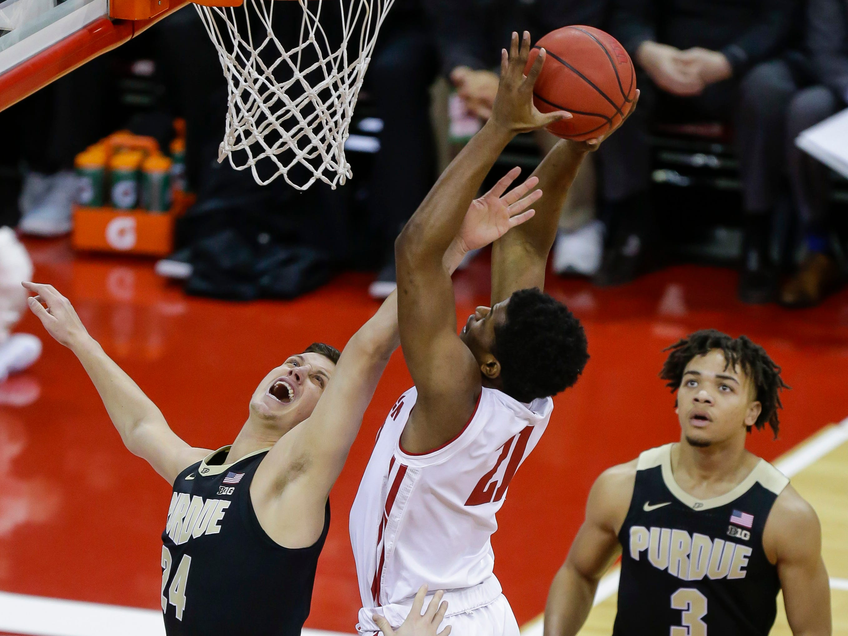 Wisconsin's Khalil Iverson goes up for a shot down low against Purdue's Grady Eifert during the first half Friday.