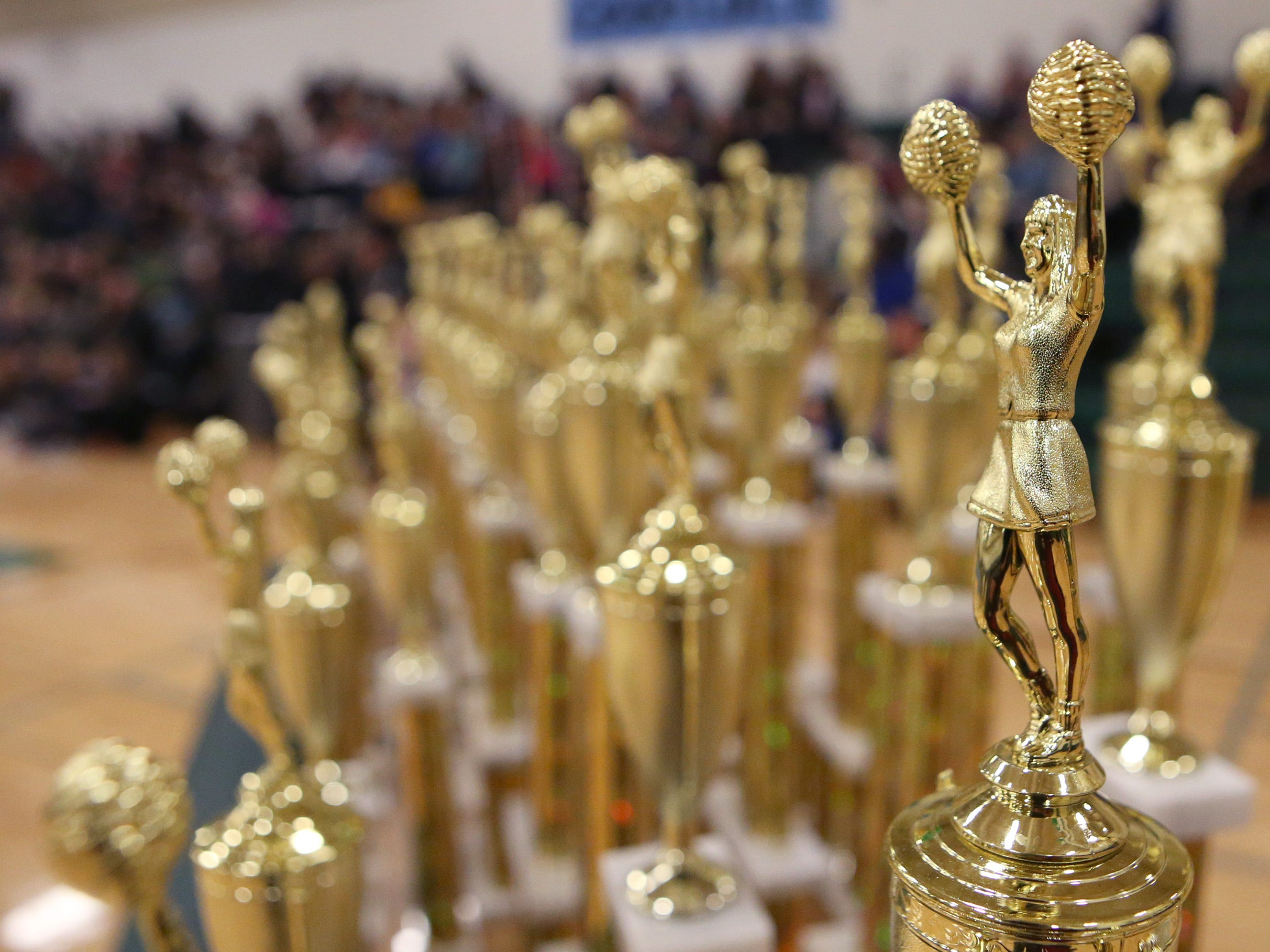 Trophies await the final results from the Greenfield Xtreme Cheer competition at Greenfield High School on Jan. 12 that drew 56 teams competing in 13 divisions.