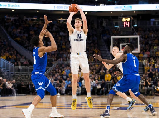 Marquette'd Sam Hauser shoots during the first half against Seton Hall on Saturday.