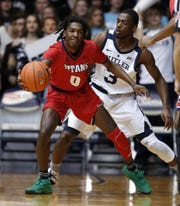 Detroit Mercy Titans guard Antoine Davis (0) keeps the ball away from Butler Bulldogs guard Kamar Baldwin (3) in the first half of their game at Hinkle Fieldhouse on Monday, Nov. 12, 2018.