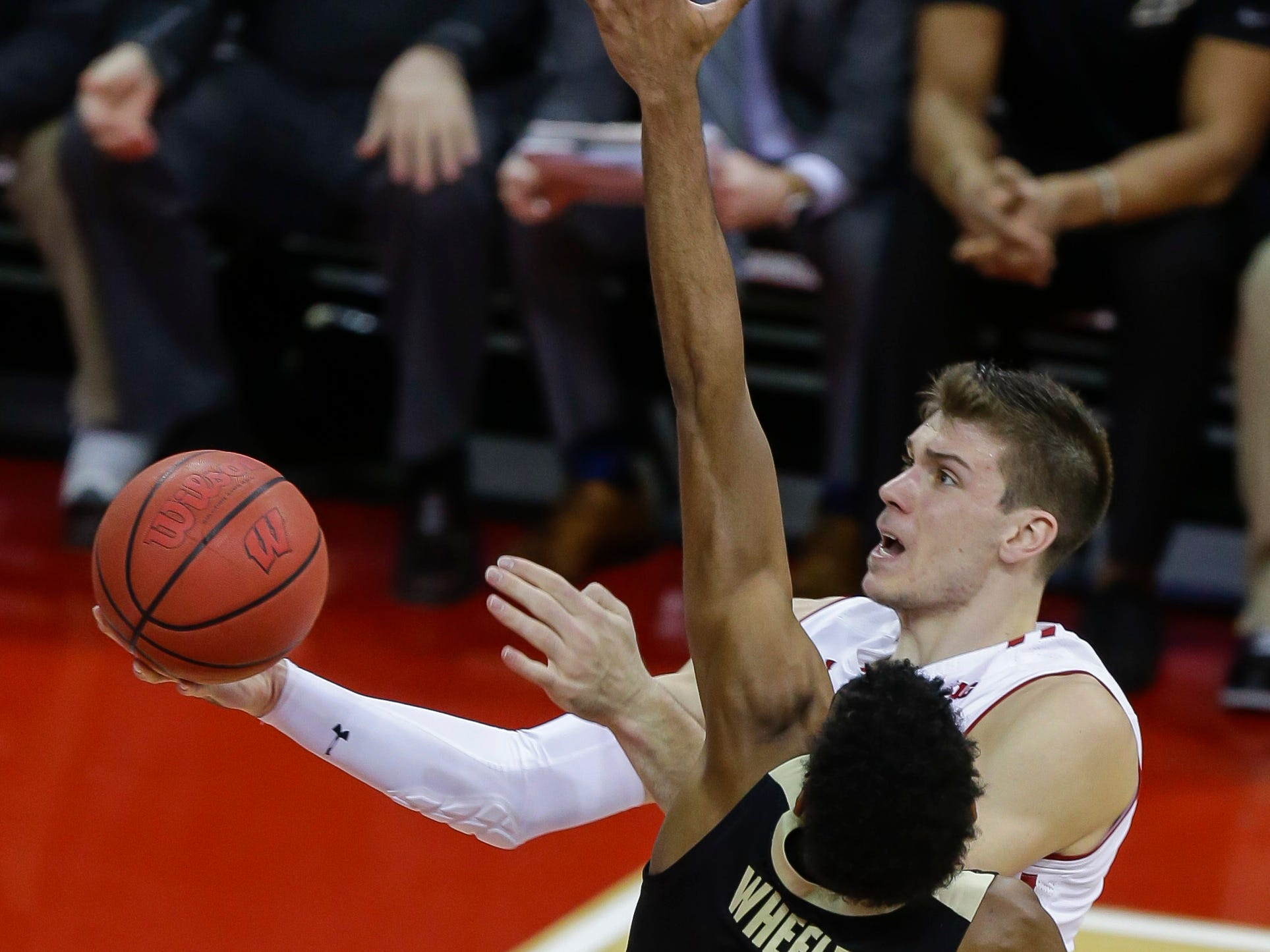 Wisconsin's Ethan Happ goes in for a shot against Purdue's Aaron Wheeler during the first half Friday.