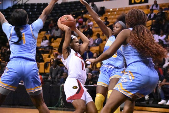 Southern defenders swarm Grambling State sophomore guard Ariel Williams (11) during Saturday's SWAC game at Fredreck Hobdy Assembly Center.