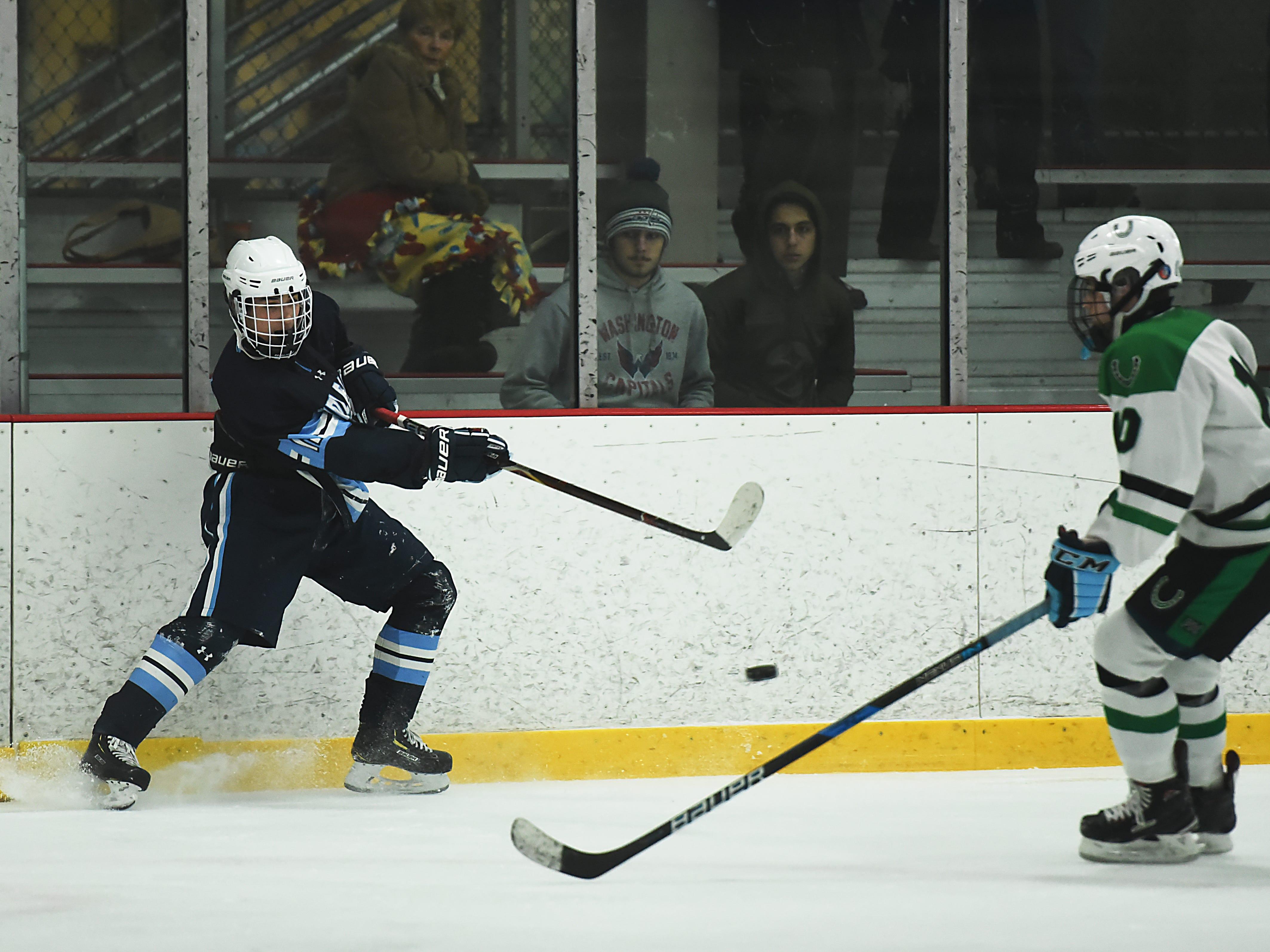 Kinnelon vs. West Morris hockey game at Skylands Ice World in Stockholm on Friday January 11, 2019. (From left) WM#11 Max Michalski and K#10 Evan Granier.