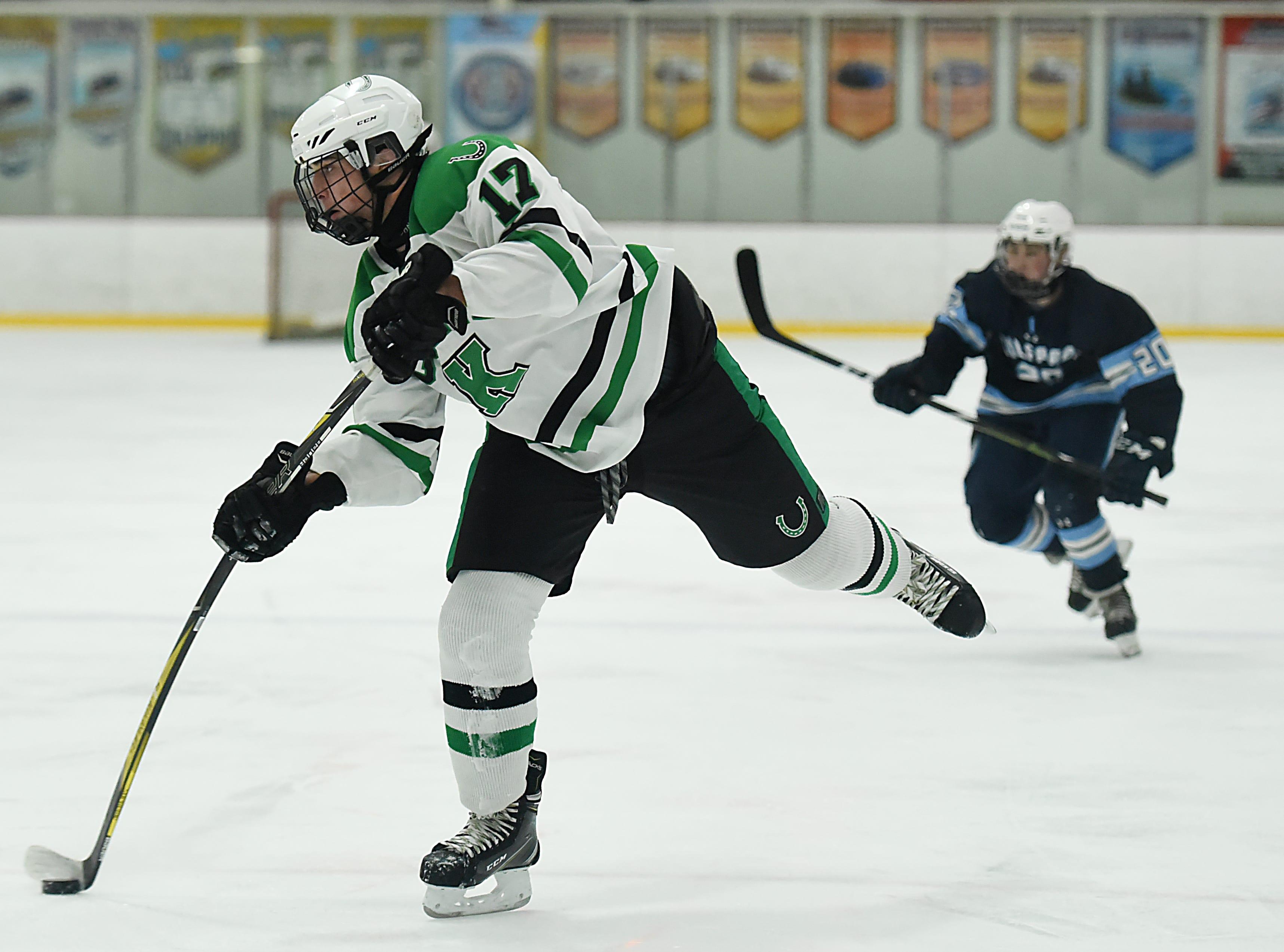 Kinnelon vs. West Morris hockey game at Skylands Ice World in Stockholm on Friday January 11, 2019. K#17 Jared Fatzer shoots.