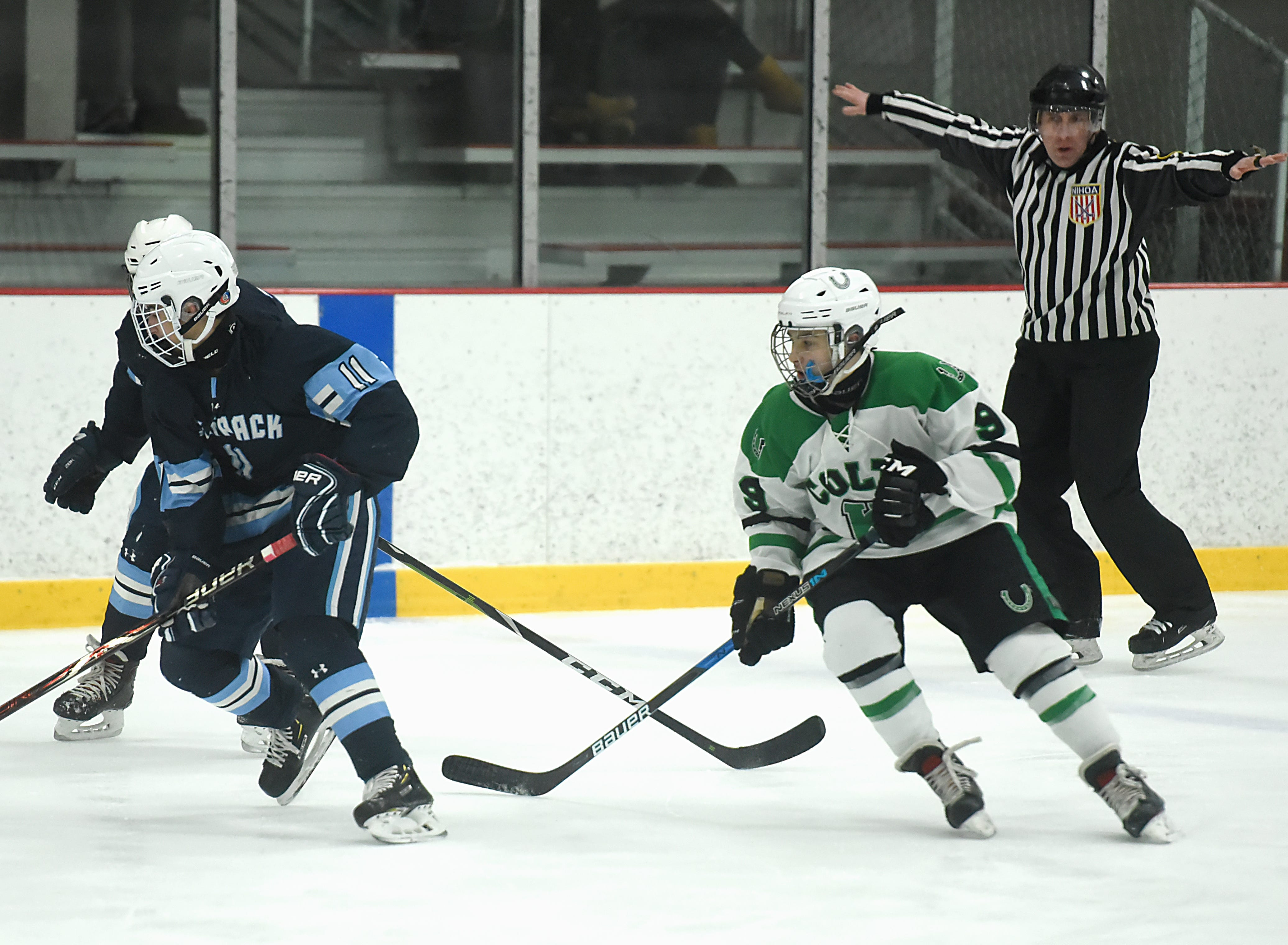Kinnelon vs. West Morris hockey game at Skylands Ice World in Stockholm on Friday January 11, 2019. (From left) WM#11 Max Michalski and K#9 Joey Arnold.