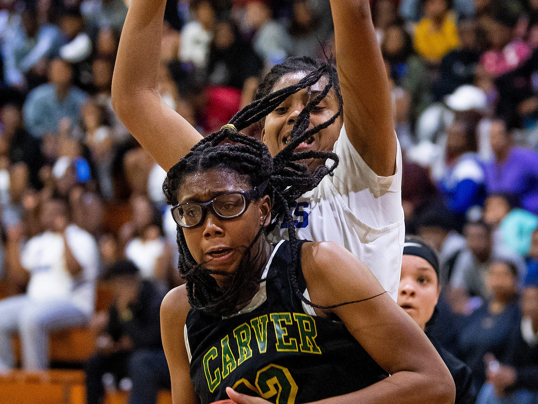 Carver's Mya Barnes (12) grabs a rebound against Lanier at the Lanier campus in Montgomery, Ala., on Friday January 11, 2019.