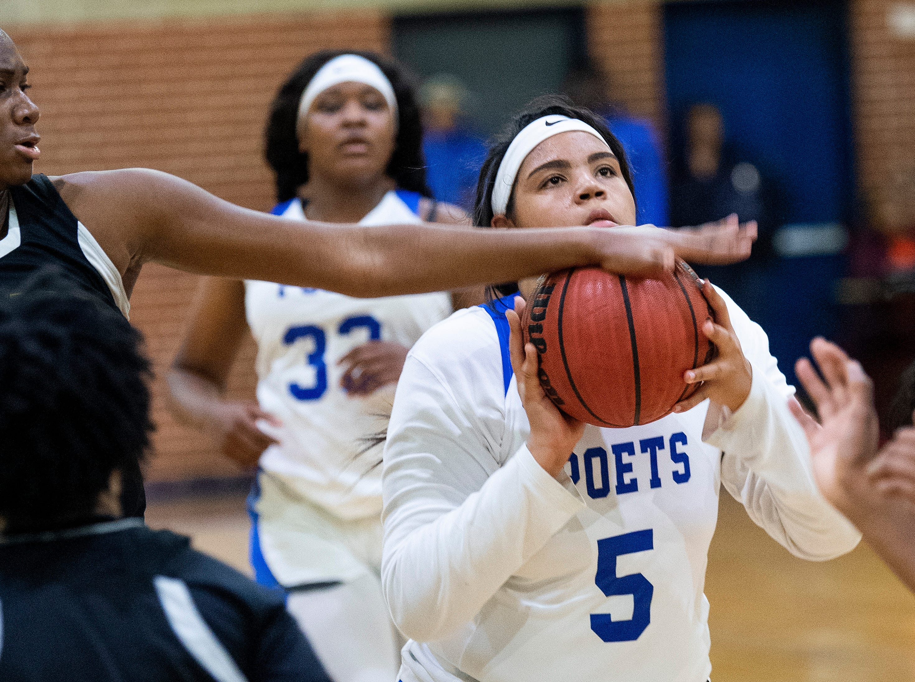 Lanier's Sakoya Knight (5) has a shot blocked by Carver's Bre anna Rhodes (10) at the Lanier campus in Montgomery, Ala., on Friday January 11, 2019.