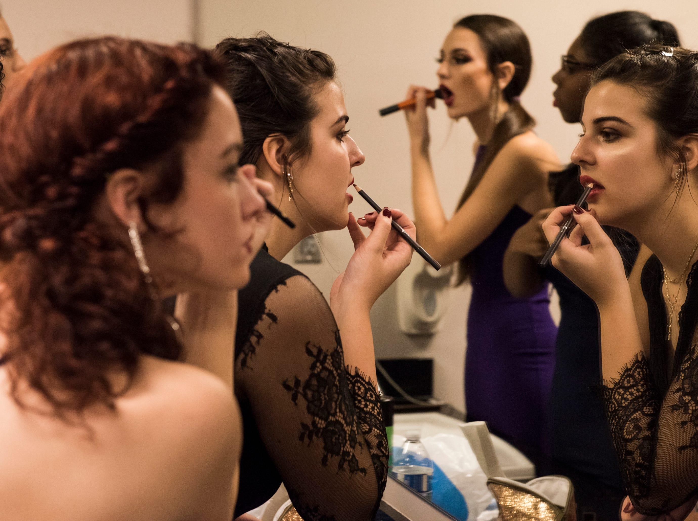 Students get ready before the BTW Showcase: Rise at the Montgomery Performing Arts Center in Montgomery, Ala., on Friday, Jan. 11, 2019.