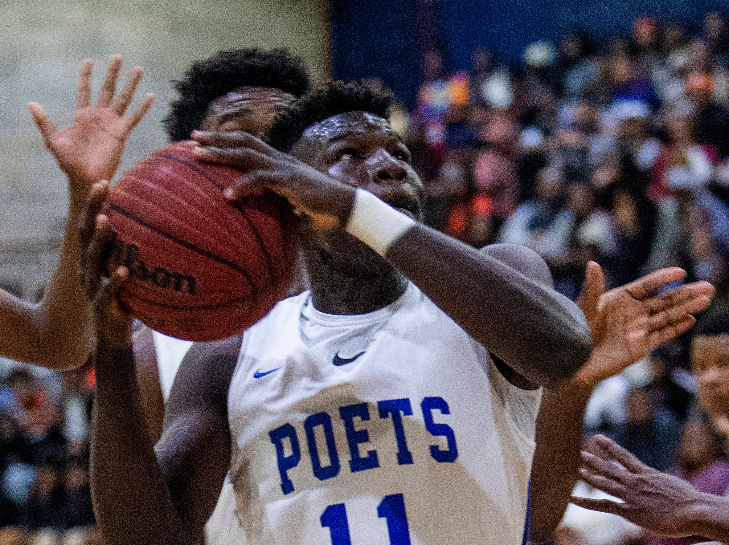 Lanier's Antwan Burnett (11) against Carver at the Lanier campus in Montgomery, Ala., on Friday January 11, 2019.