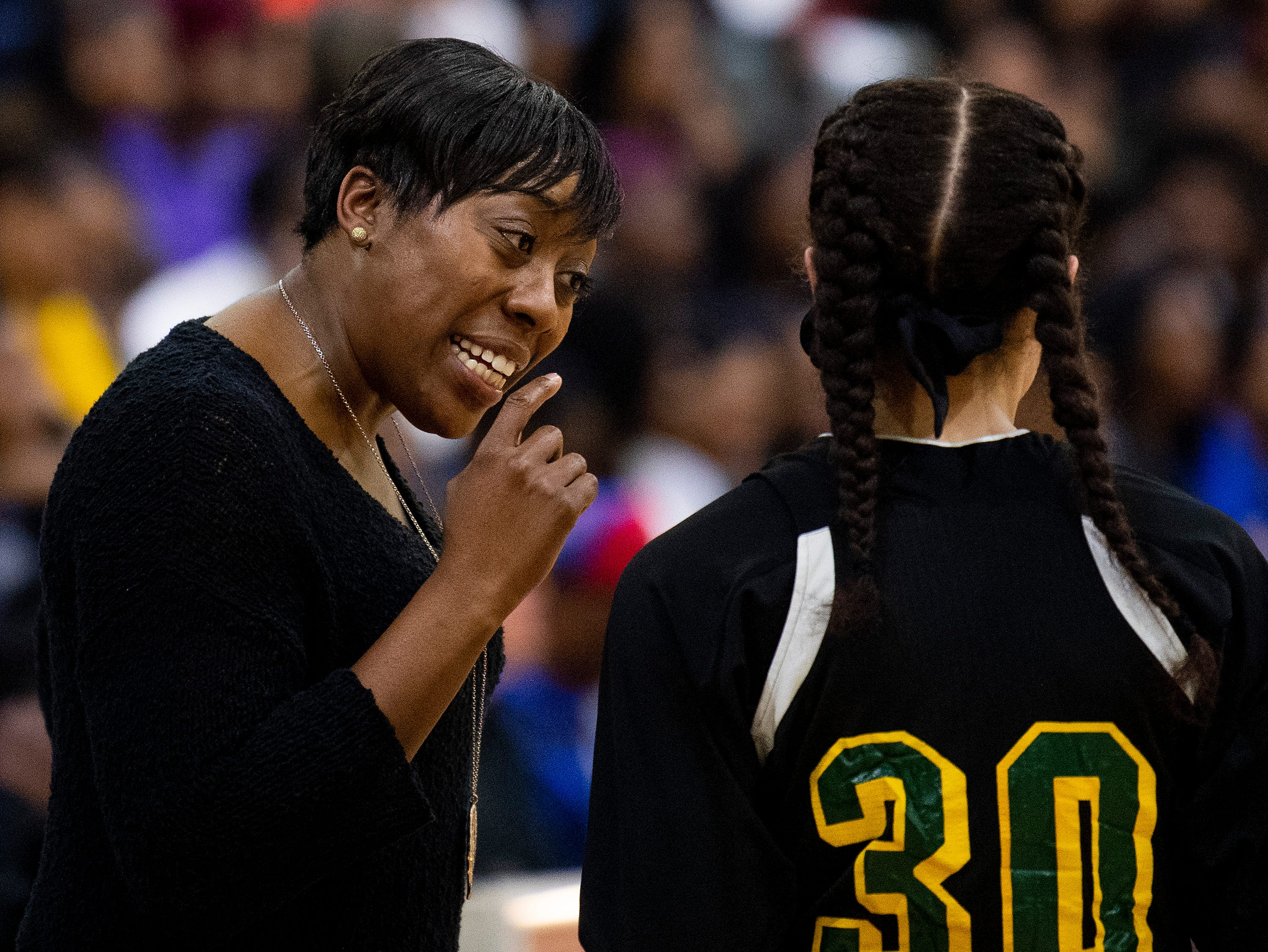Carver coach Adria Harris  talks with Carver's Kristin Brown (30) at the Lanier campus in Montgomery, Ala., on Friday January 11, 2019.