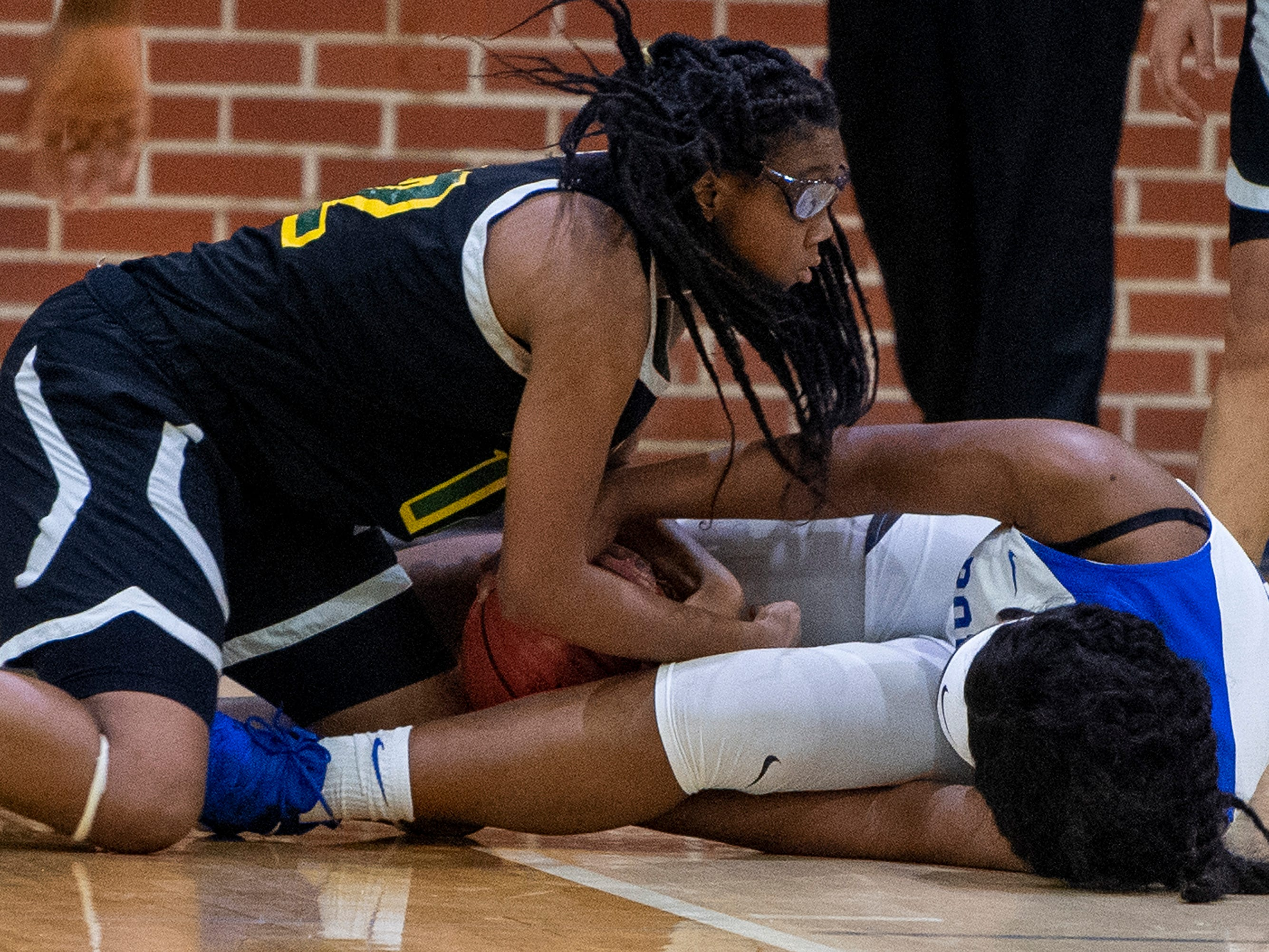 Carver's Mya Barnes (12)  and Lanier's Kadresha Smith (33)  go after a loose ball at the Lanier campus in Montgomery, Ala., on Friday January 11, 2019.