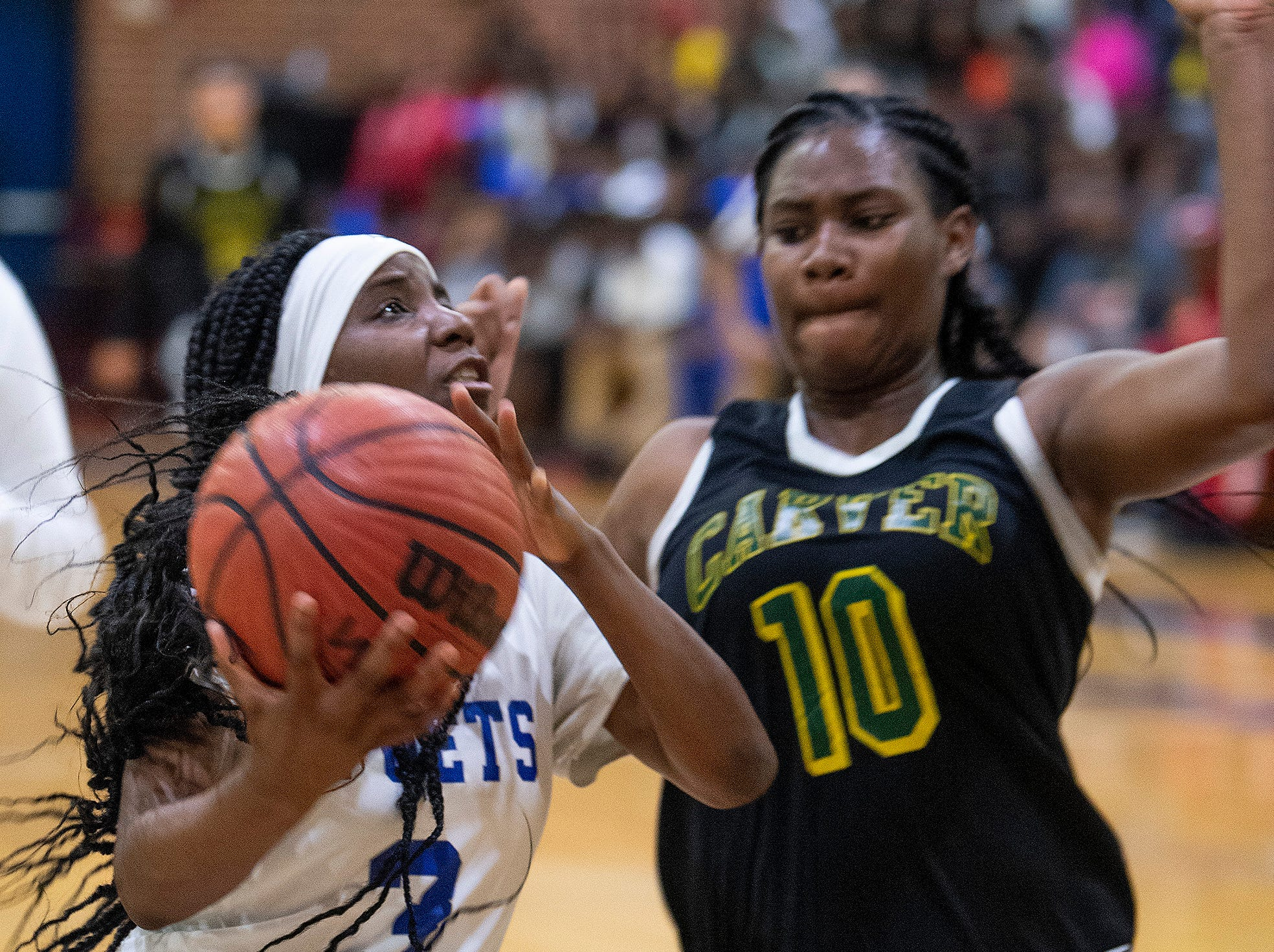 Lanier's Tamia Blair (3) is defended by Carver's Bre anna Rhodes (10) at the Lanier campus in Montgomery, Ala., on Friday January 11, 2019.