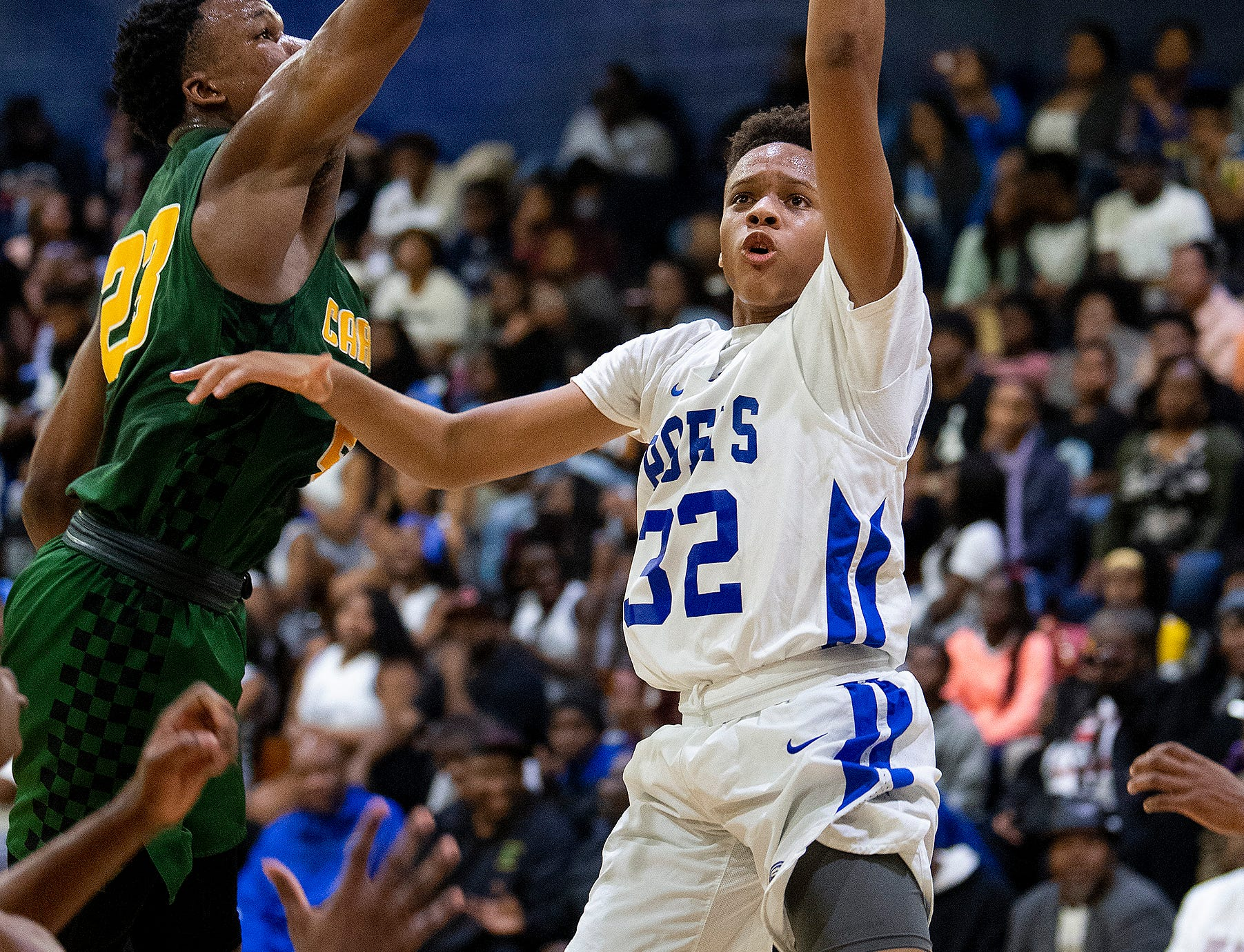 Lanier's Joshua Williams (32) against Carver at the Lanier campus in Montgomery, Ala., on Friday January 11, 2019.