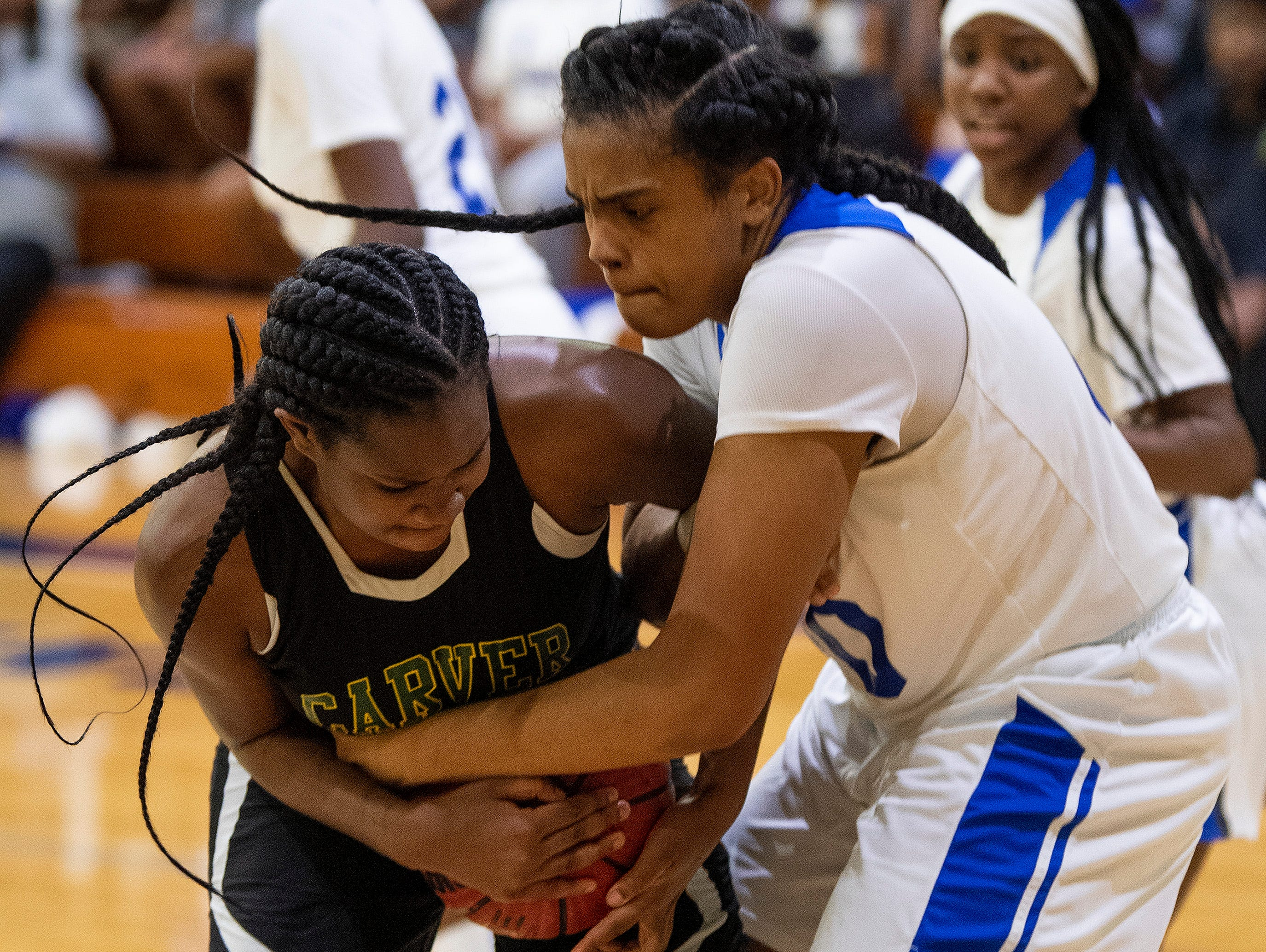 Carver's Bre anna Rhodes (10)  and Lanier's Tierra Davis (40) go after the ball at the Lanier campus in Montgomery, Ala., on Friday January 11, 2019.