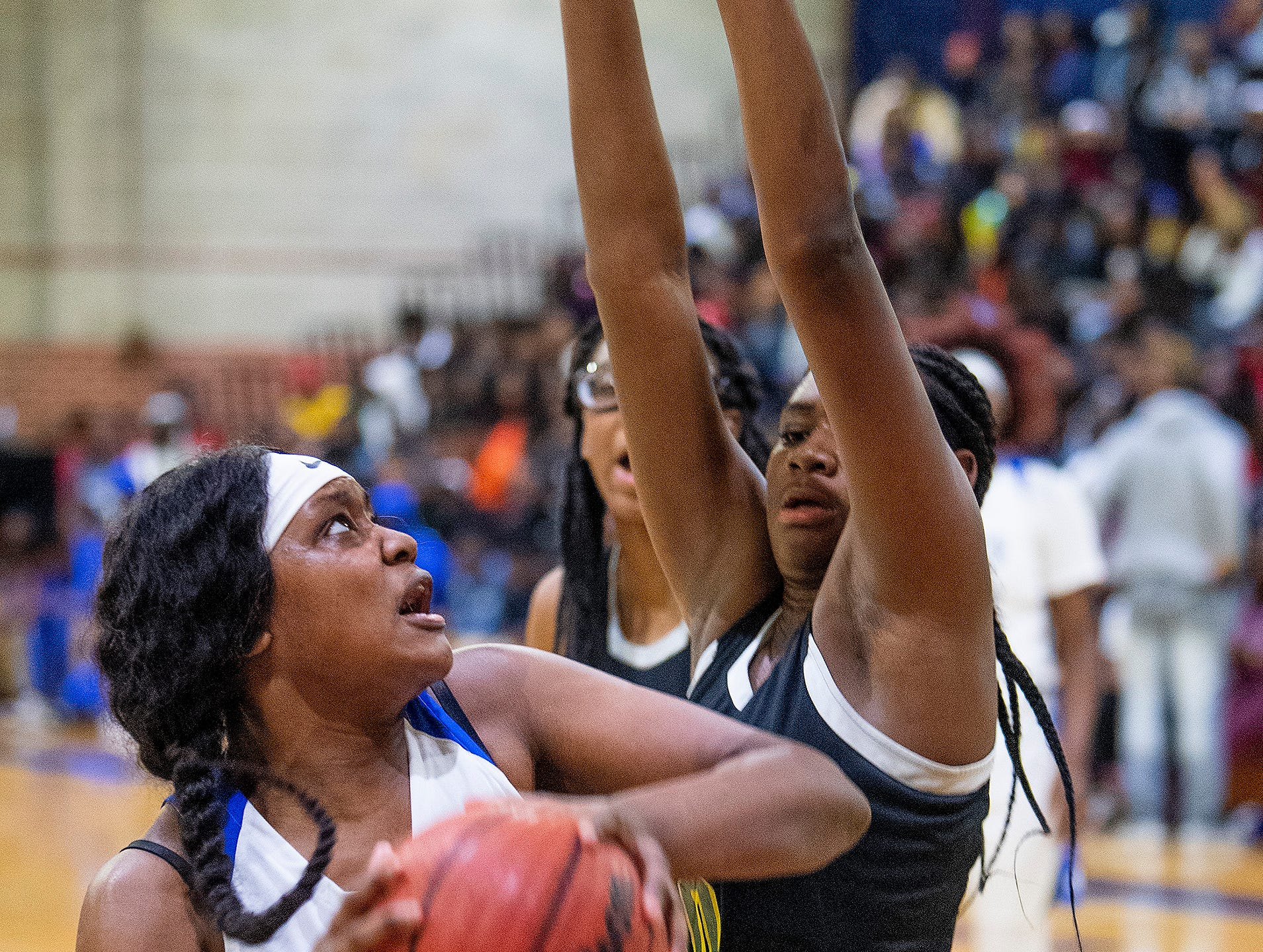 Lanier's Kadresha Smith (33) is defended by Carver's Bre anna Rhodes (10) at the Lanier campus in Montgomery, Ala., on Friday January 11, 2019.