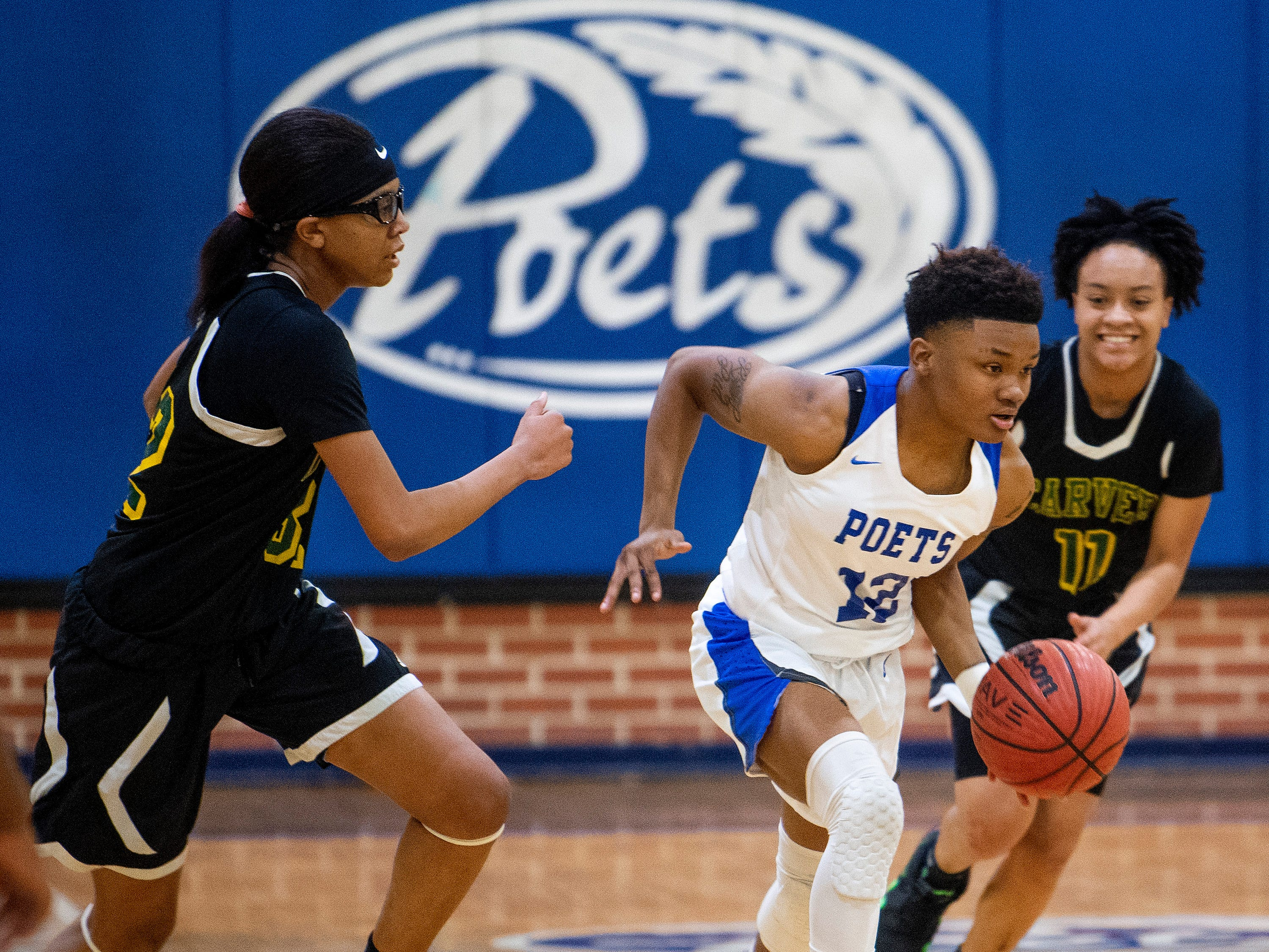 Lanier's Tynija Blue (12) against Carver at the Lanier campus in Montgomery, Ala., on Friday January 11, 2019.