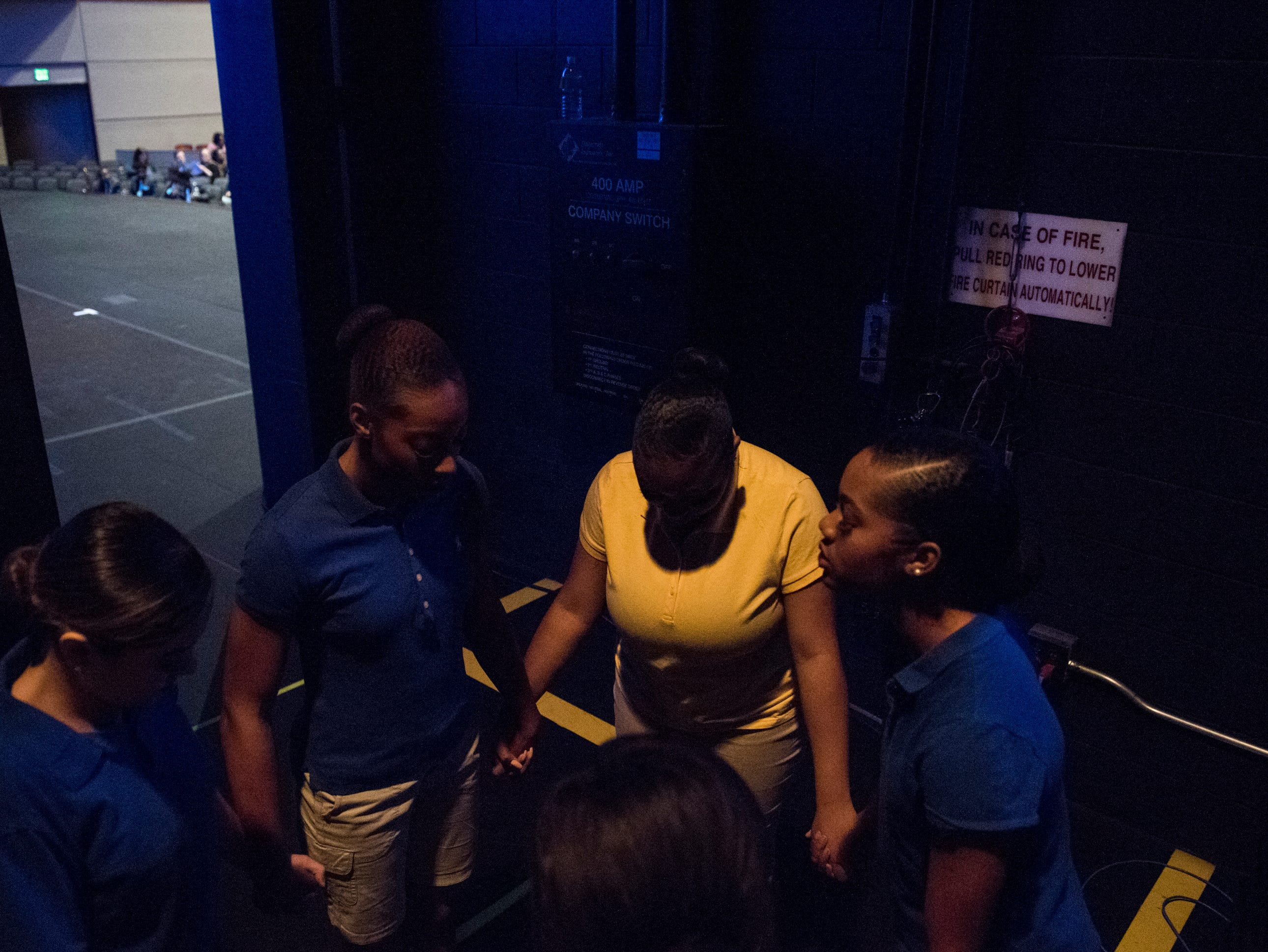 Student dancers pray before the BTW Showcase: Rise at the Montgomery Performing Arts Center in Montgomery, Ala., on Friday, Jan. 11, 2019.