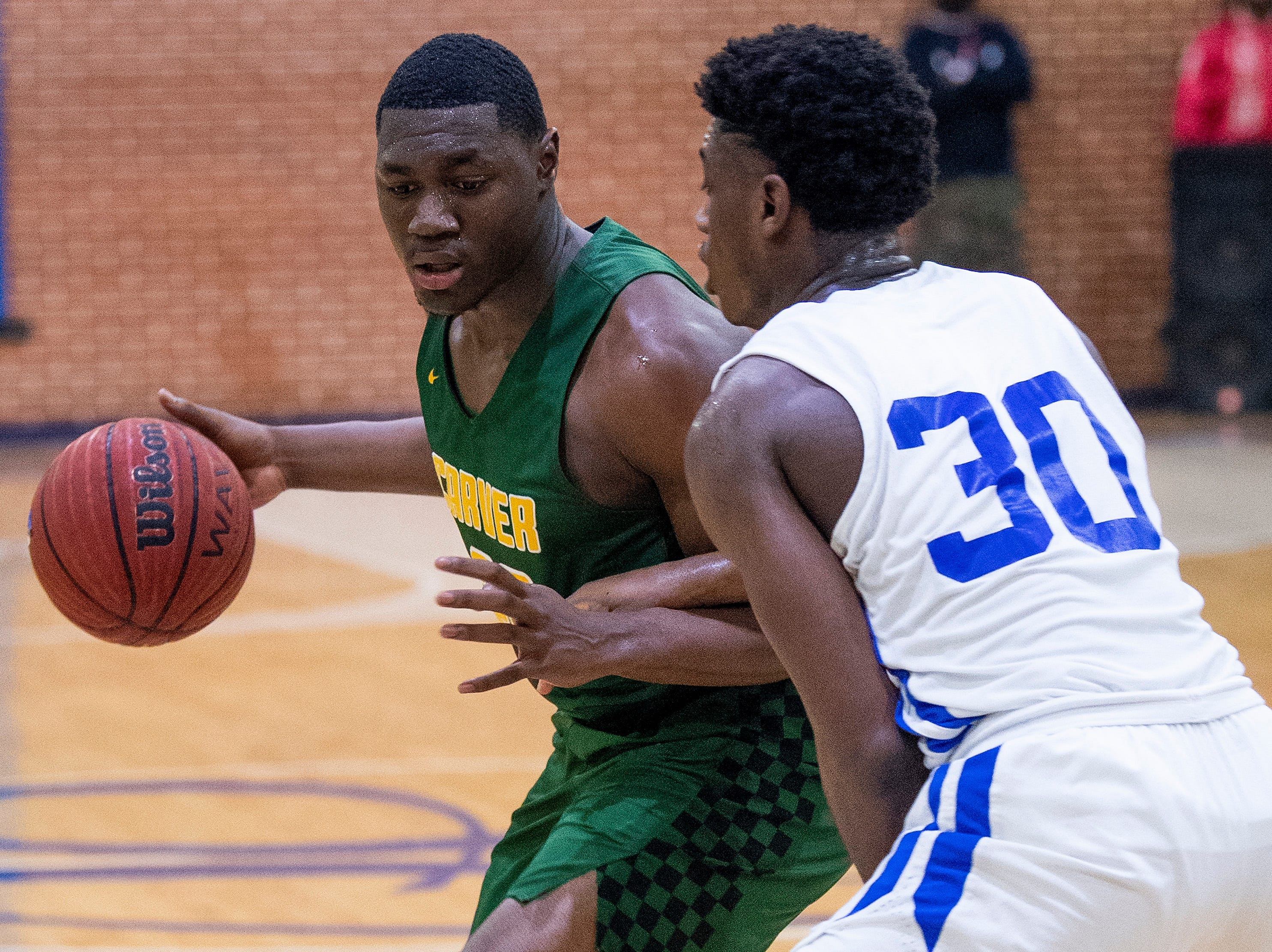 Carver's Jereme Robinson (20) and Lanier's Rongie Gordon (30) at the Lanier campus in Montgomery, Ala., on Friday January 11, 2019.