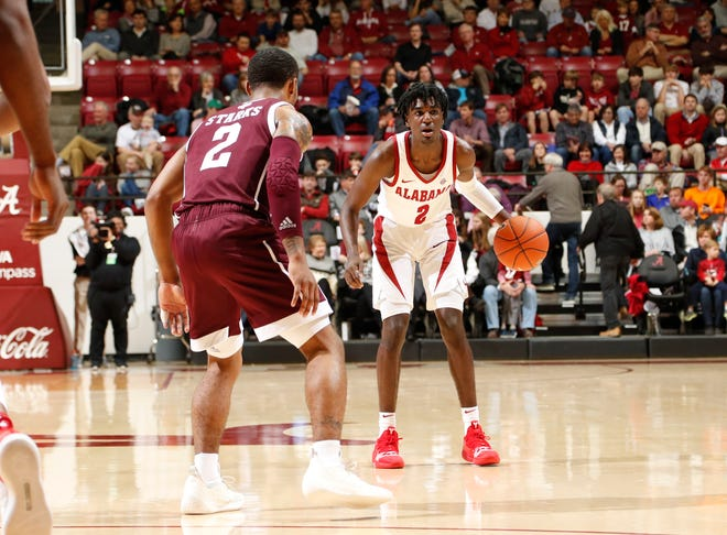 Alabama freshman guard Kira Lewis (2) is defended by Texas A&M sophomore guard TJ Starks, whose buzzer-beating 3-pointer sent the Aggies to a 81-80 win Saturday, Jan. 12, 2019 from Coleman Coliseum in Tuscaloosa, Ala. (Photo by Robert Sutton/Alabama athletics)