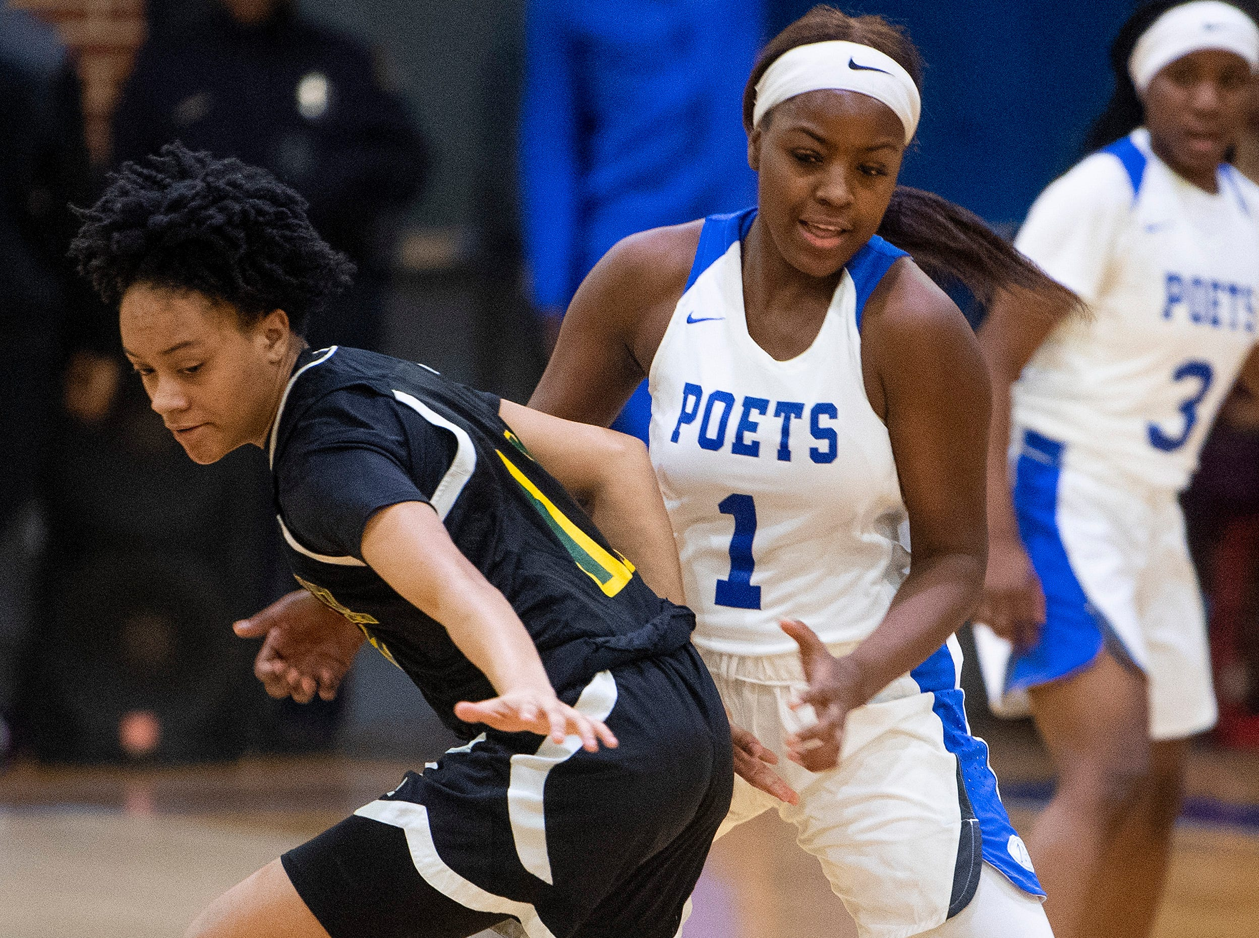 Carver's Aaliyah Ellis (11) and Lanier's Ashley Shakelford (1) go after a loose ball at the Lanier campus in Montgomery, Ala., on Friday January 11, 2019.