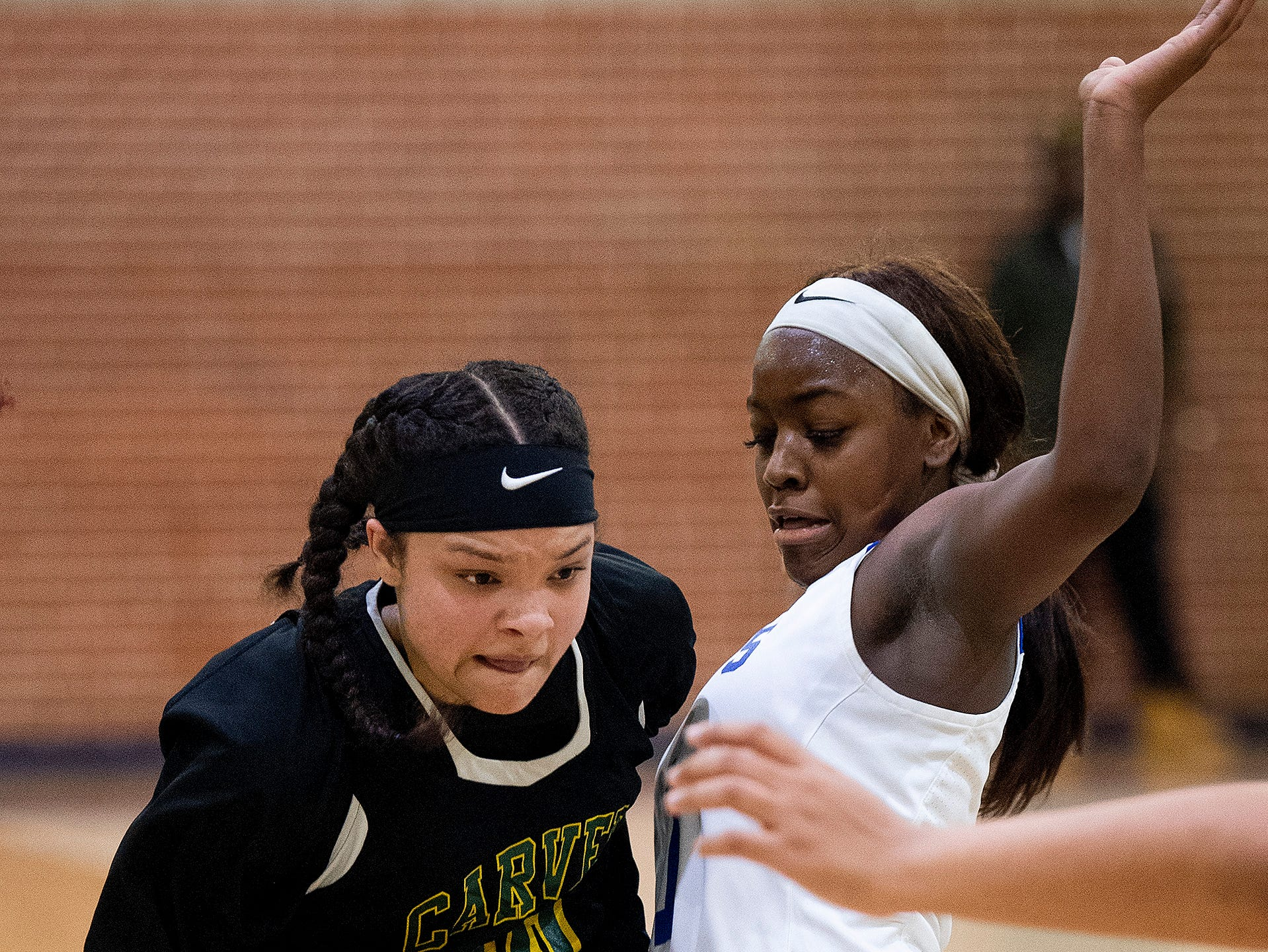 Carver's Kristin Brown (30) and Lanier's Ashley Shakelford (1) at the Lanier campus in Montgomery, Ala., on Friday January 11, 2019.