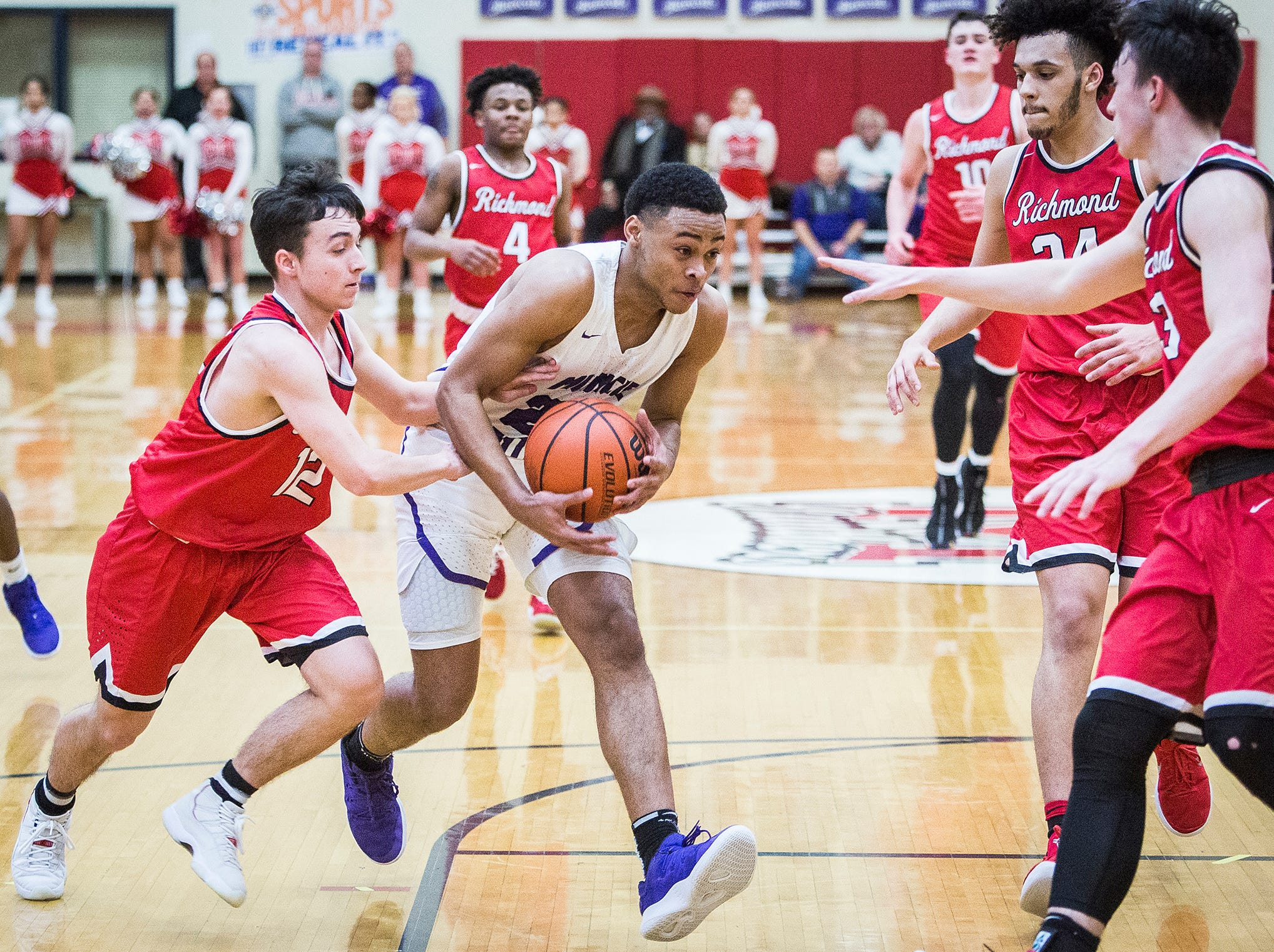 Central's Victor Young struggles past Richmond's defense during their game at Southside Middle School Friday, Jan. 11, 2019.