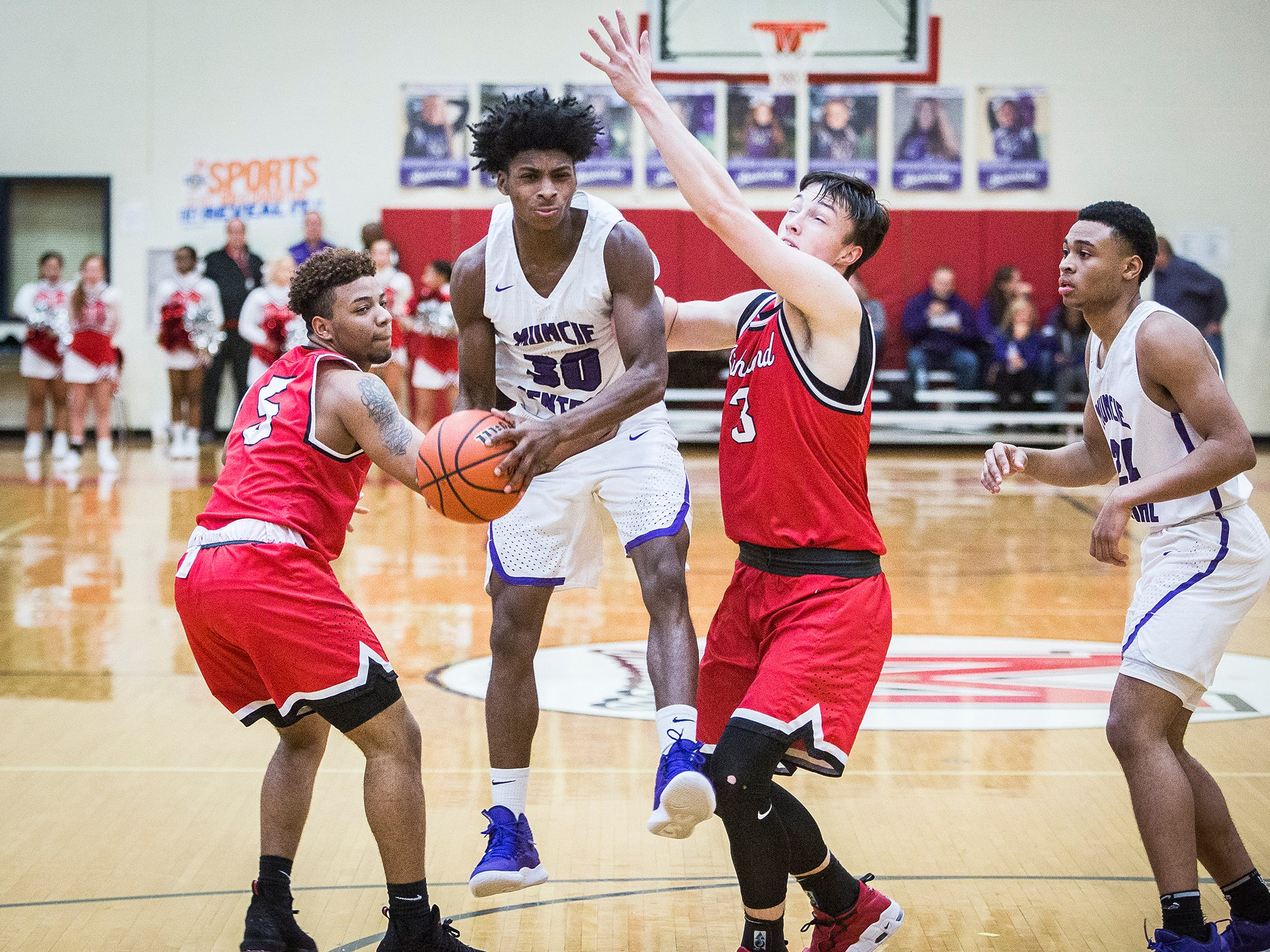 Central's Kamrein Jackson struggles past Richmond's defense during their game at Southside Middle School Friday, Jan. 11, 2019.