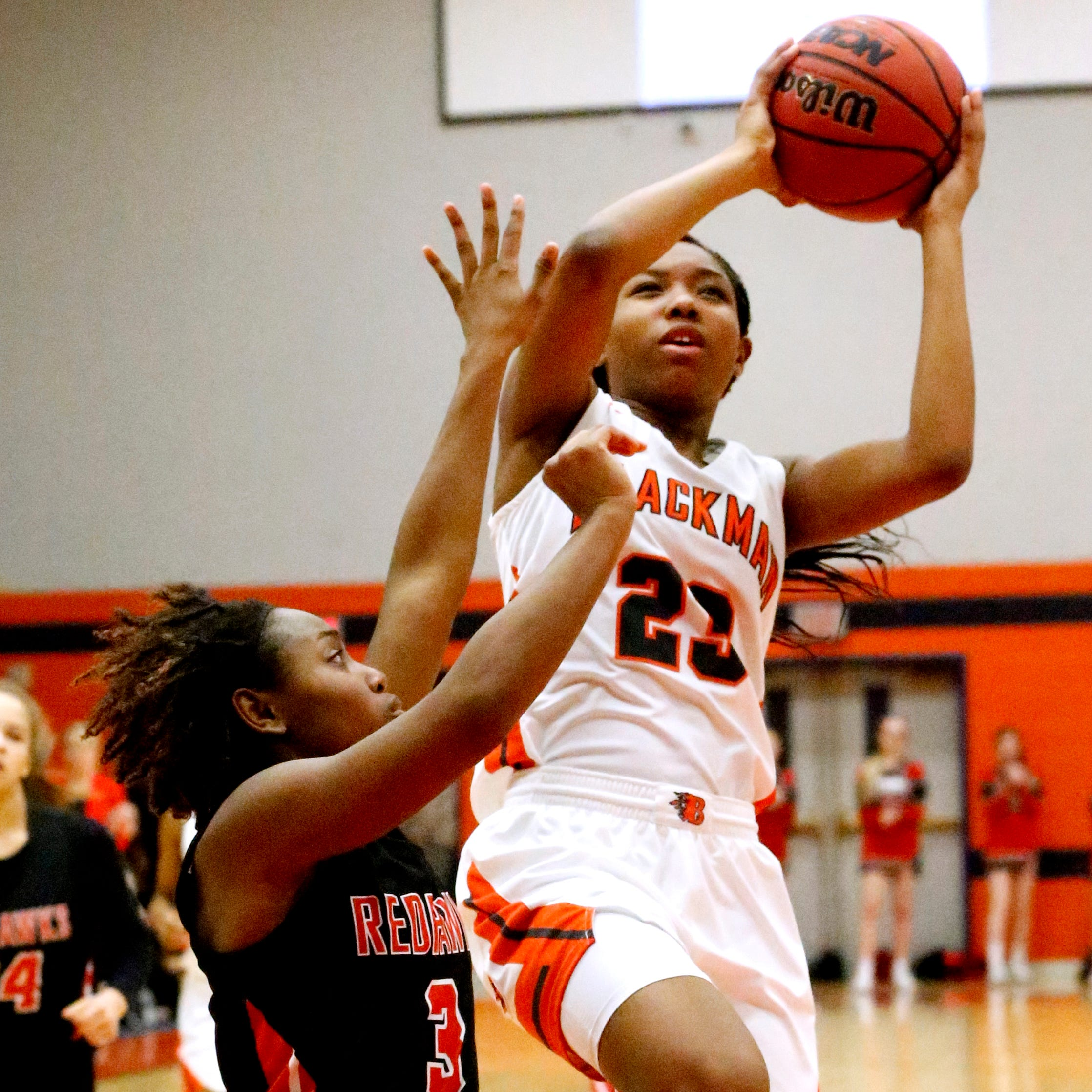 Blackman's Iyana Moore (23) goes up for a shot as Stewart Creek's Kamaria Hurse (3) guards her on Friday Jan. 11, 2019.