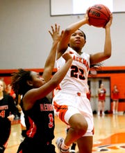 Blackman's Iyana Moore (23) goes up for a shot as Stewart Creek's Kamaria Hurse (3) guards her on Friday.
