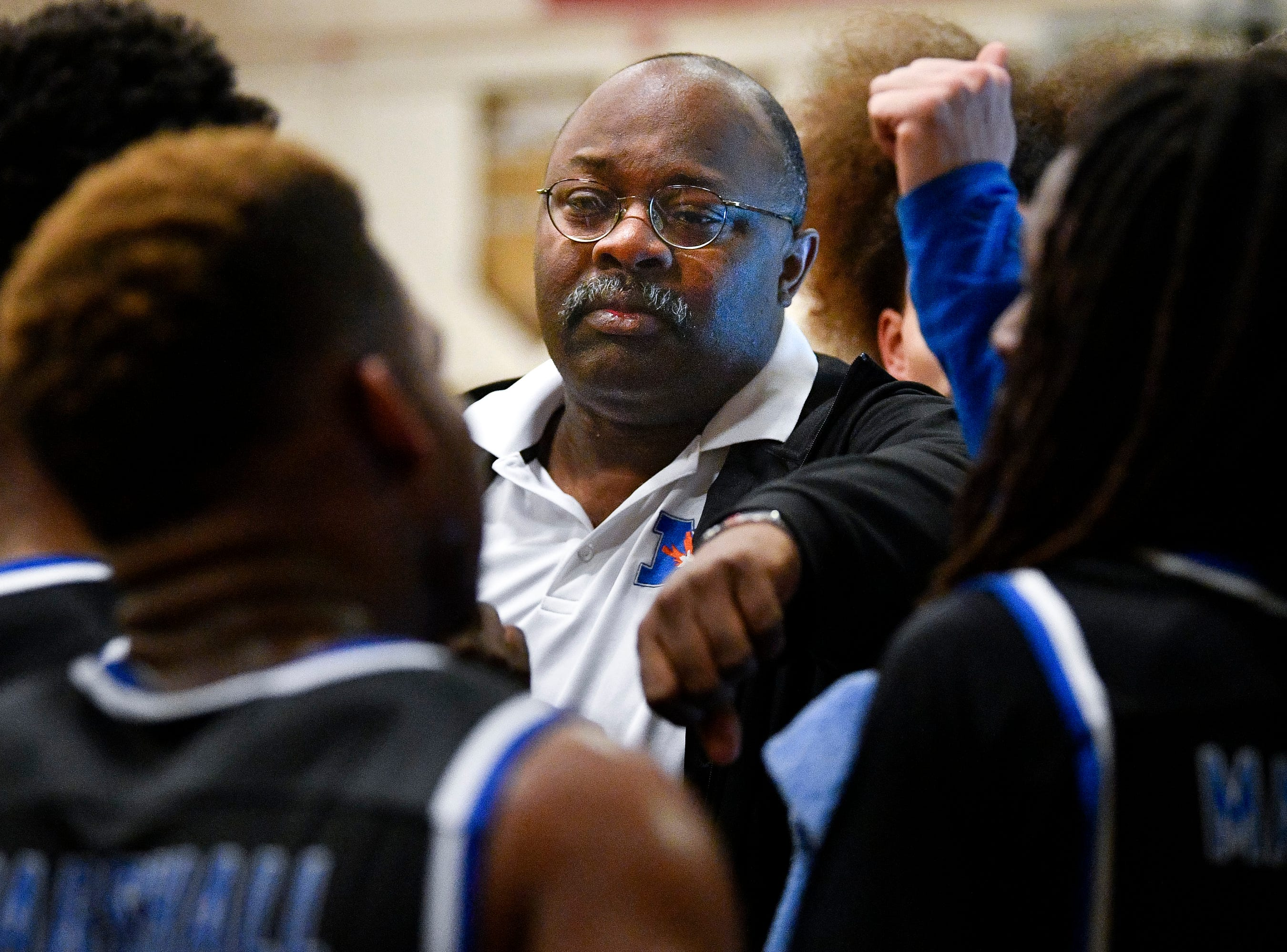 Marshall County head coach Lavon King works with his team against Central Magnet during the second half at Central Magnet School in Murfreesboro, Tenn., Friday, Jan. 11, 2019.
