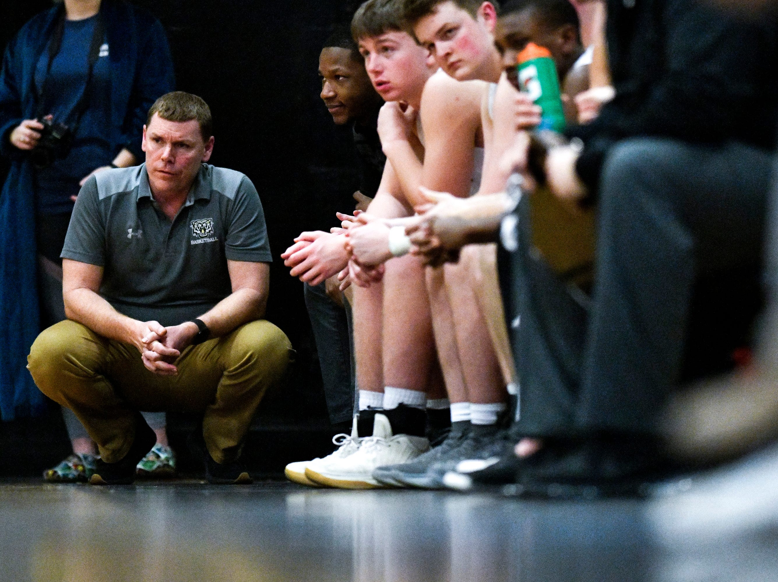 Central Magnet head coach Doug Worsley works with his team against Marshall County during the first half at Central Magnet School in Murfreesboro, Tenn., Friday, Jan. 11, 2019.