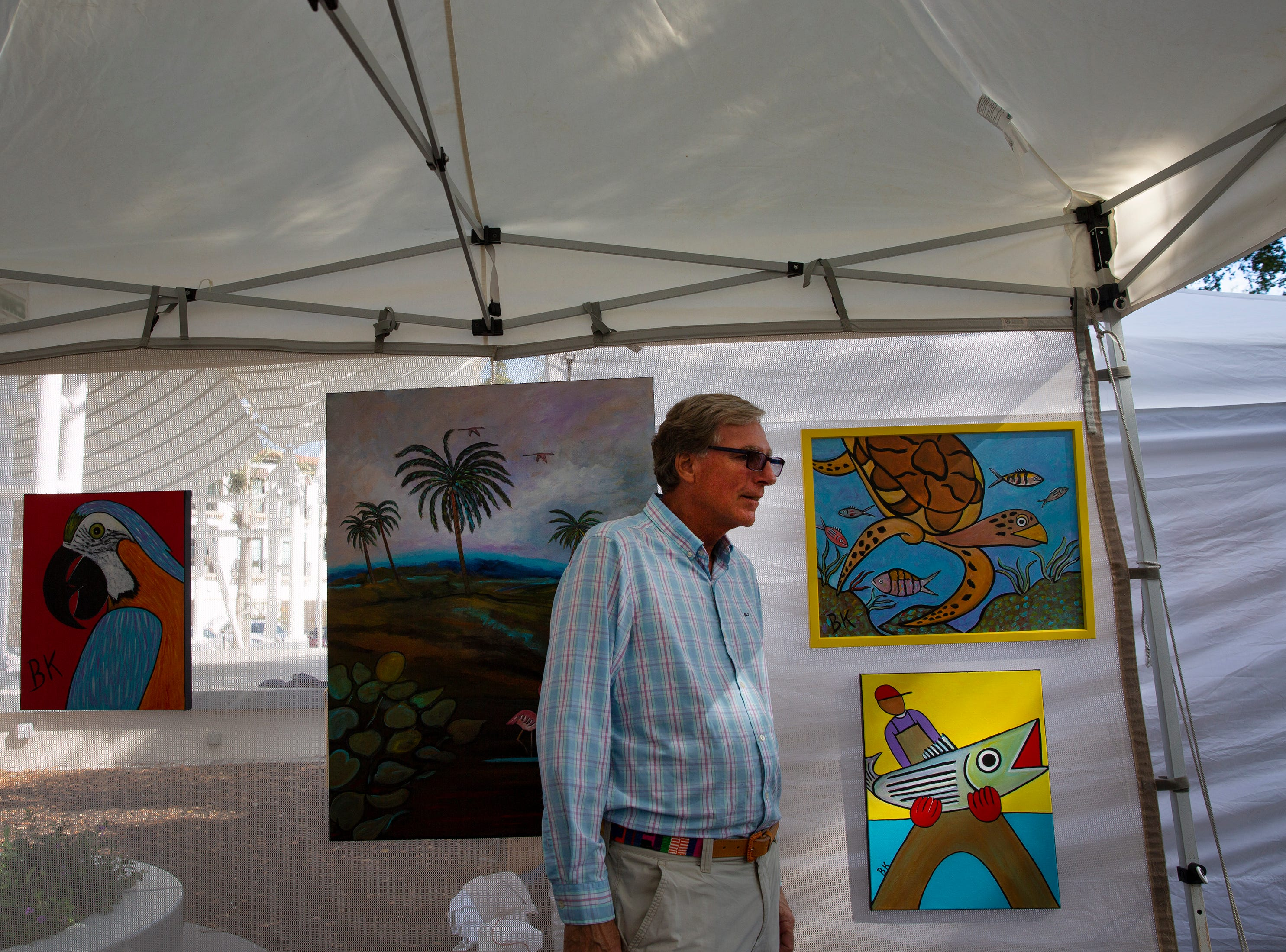Artist Brian Kirkpatrick shows off his works at the Naples Artcrafters' monthly art show, Saturday, Jan. 12, 2019, in Cambier Park in Naples.