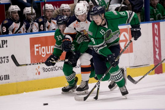 Joe Cox, left, and Kyle Platzer of the Everblades crash into Brendan Harms of Greenville on Friday at Hertz Arena in Estero. Cox is an All-Star and the Blades have the league's best record heading into the second half of the season.