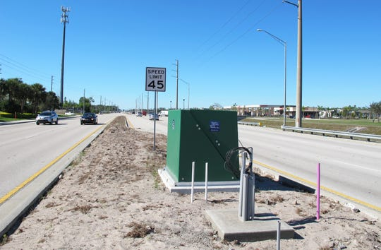 The large green boxes recently installed along Immokalee Road east of Collier Boulevard are pump stations for irrigation wells that are part of Collier County's median landscaping project to be completed this spring.