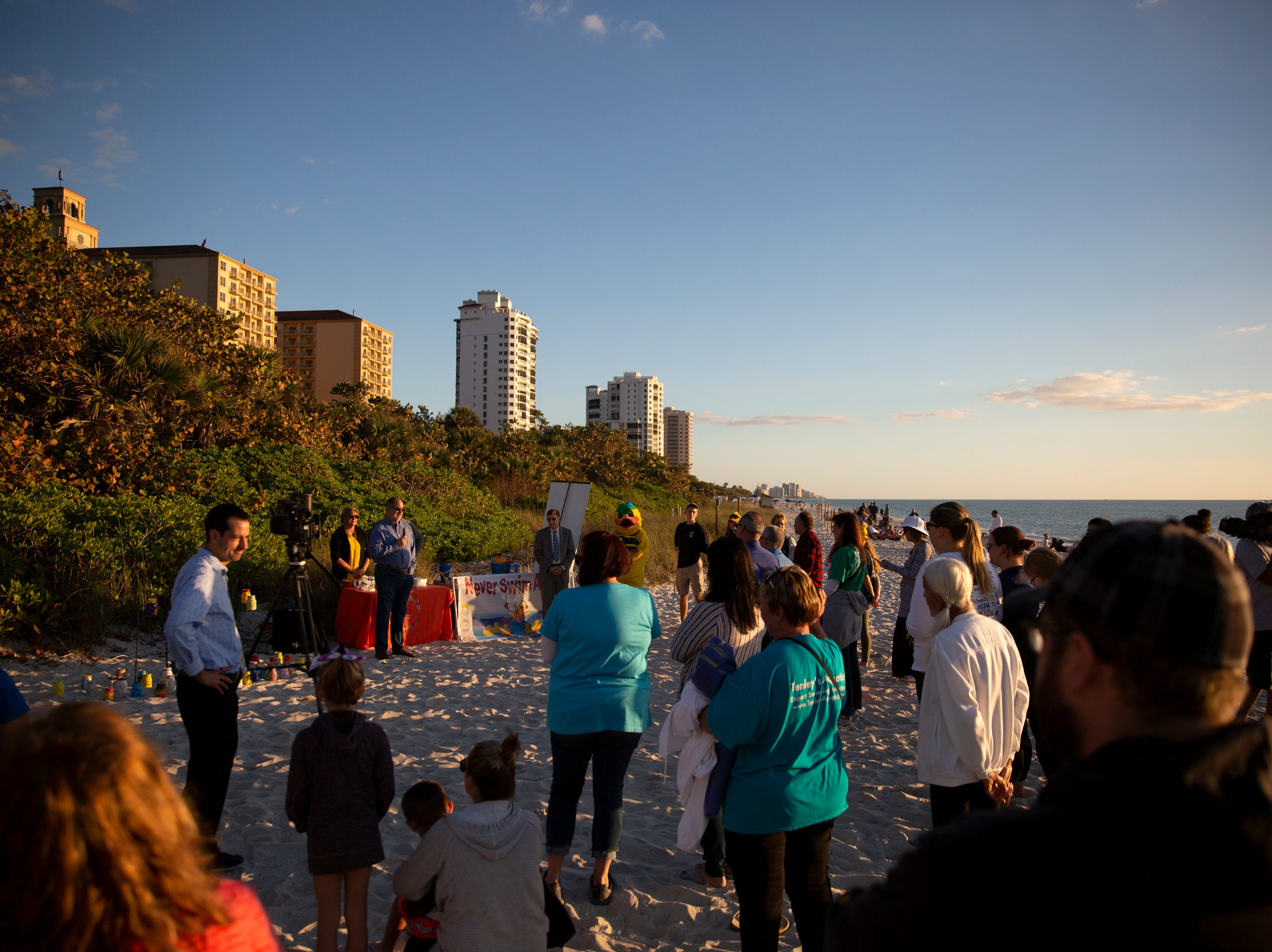 Community members gather to remember local children who have died due to drowning during the 6th Annual Twin Tot Walk Vigil, Friday, Jan. 11, 2019, at Vanderbilt Beach.