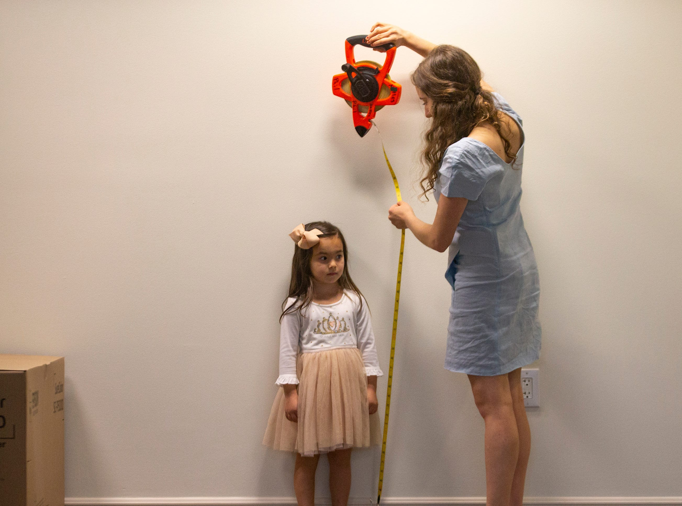 "Emma Panos, 3, of Naples, is measured by Susanna Wolk, the assistant director for the upcoming production of ""Waitress,"" during a casting call for the role of Lulu on Saturday, Jan. 12, 2019, at the Artis—Naples Toni Stabile Education Building."