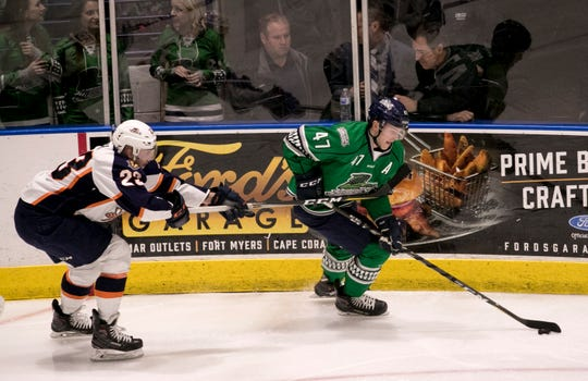 Logan Roe of the Everblades skates toward the goal in front of Michael Pelech of Greenville on Friday at Hertz Arena in Estero. The Fort Myers native leads the ECHL in plus-minus heading into the second half of the season.
