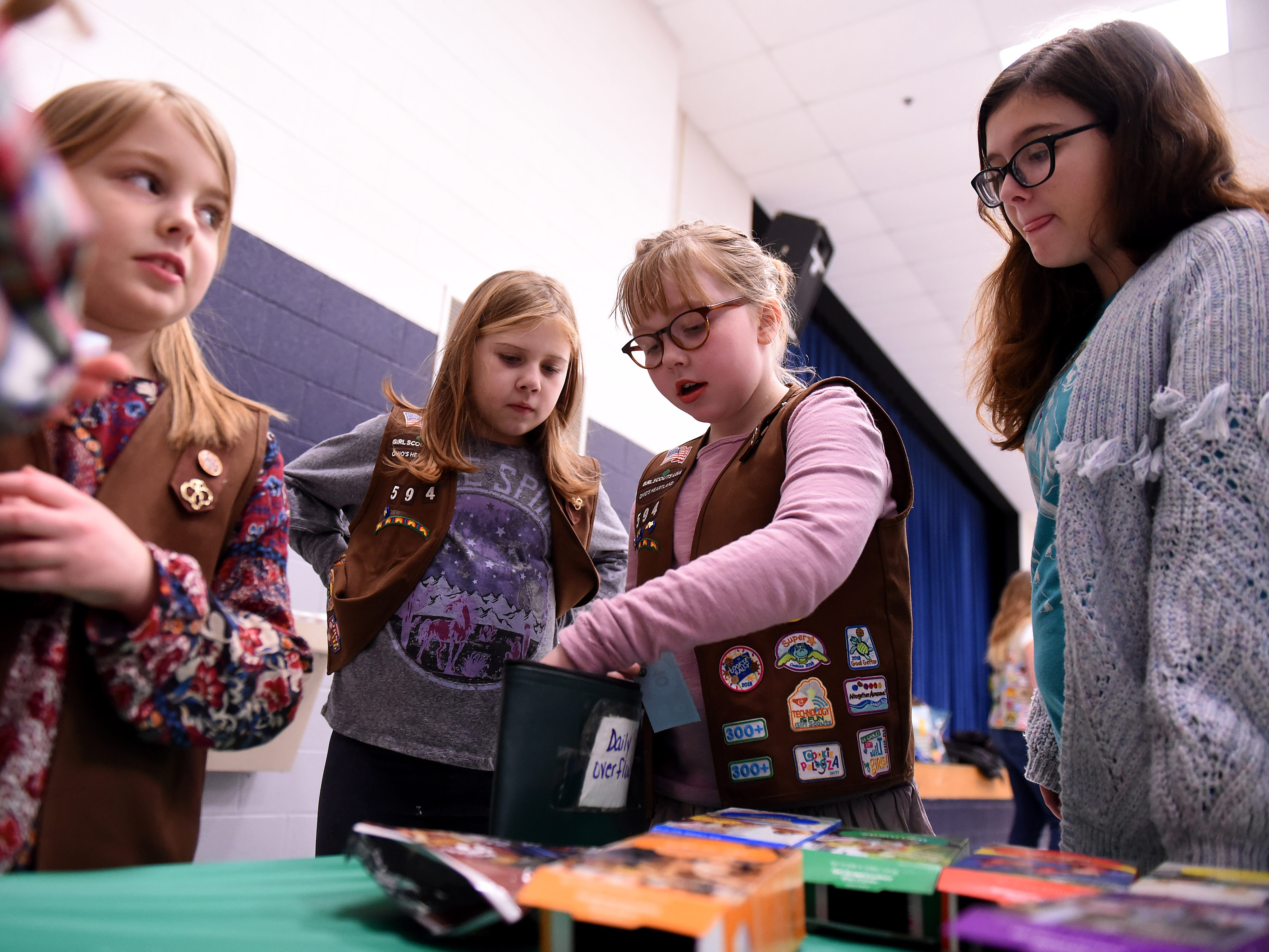 Girl Scouts from Granville area troops gathered for a cookie rally at Granville Elementary on Friday, Jan. 11, 2019. Scouts meet to sample cookies, practice making change and calculating cost, and other entrepreneur skills during the event to start the Girl Scout cookie season. The gathering of Granville area troops selected the new S'mores cookie as their favorite in a poll. Local scouts will be taking orders through January 27th and then will be selling at booths locally through March 24.