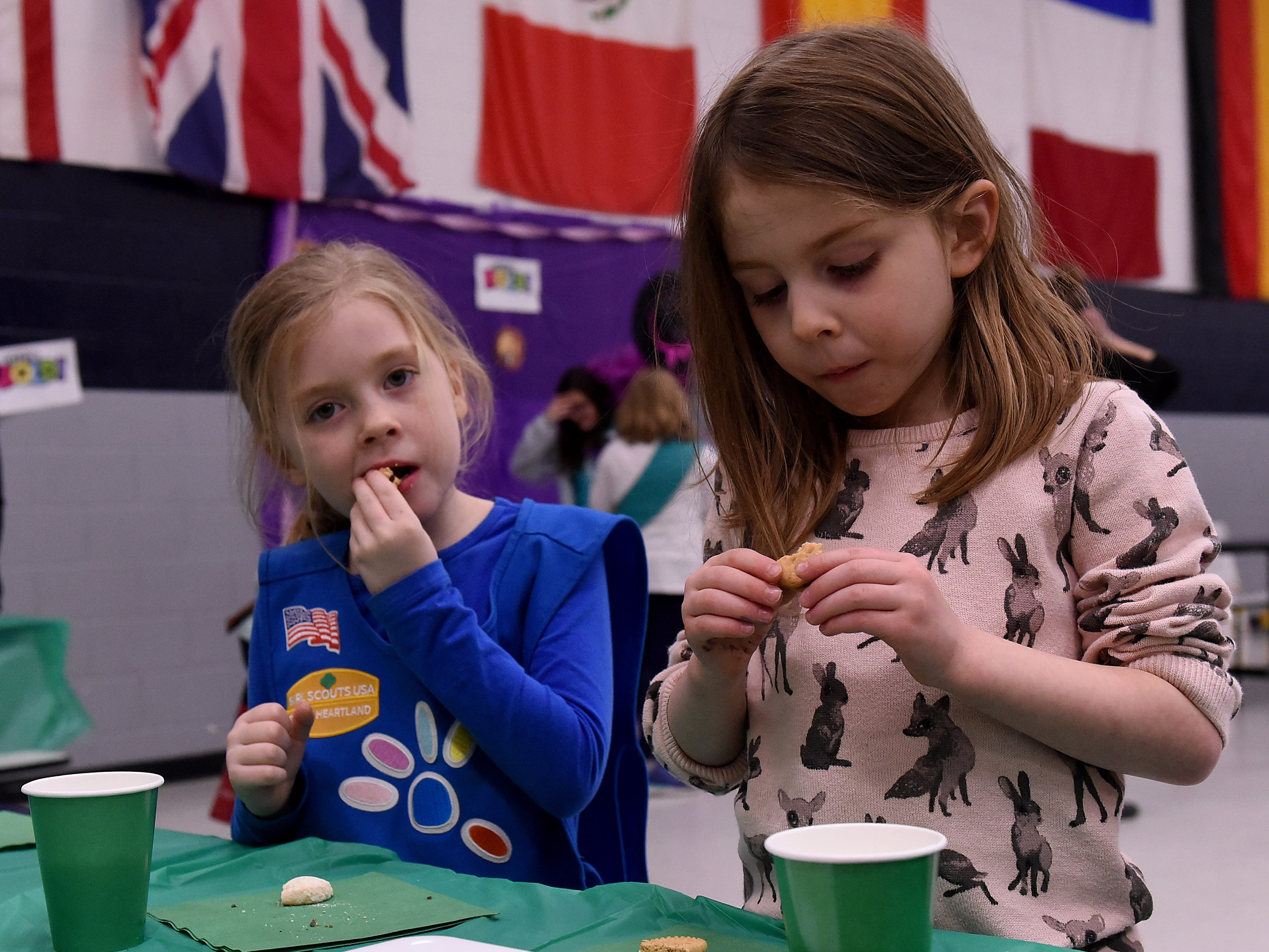 Daisy Girl Scouts Katie Clifford and Fiona Phennicie sample cookies and try to decide on their favorite during a cookie rally at Granville Elementary on Friday, Jan. 11, 2019. Scouts meet to sample cookies, practice making change and calculating cost, and other entrepreneur skills during the event to start the Girl Scout cookie season. The gathering of Granville area troops selected the new S'mores cookie as their favorite in a poll. Local scouts will be taking orders through January 27th and then will be selling at booths locally through March 24.