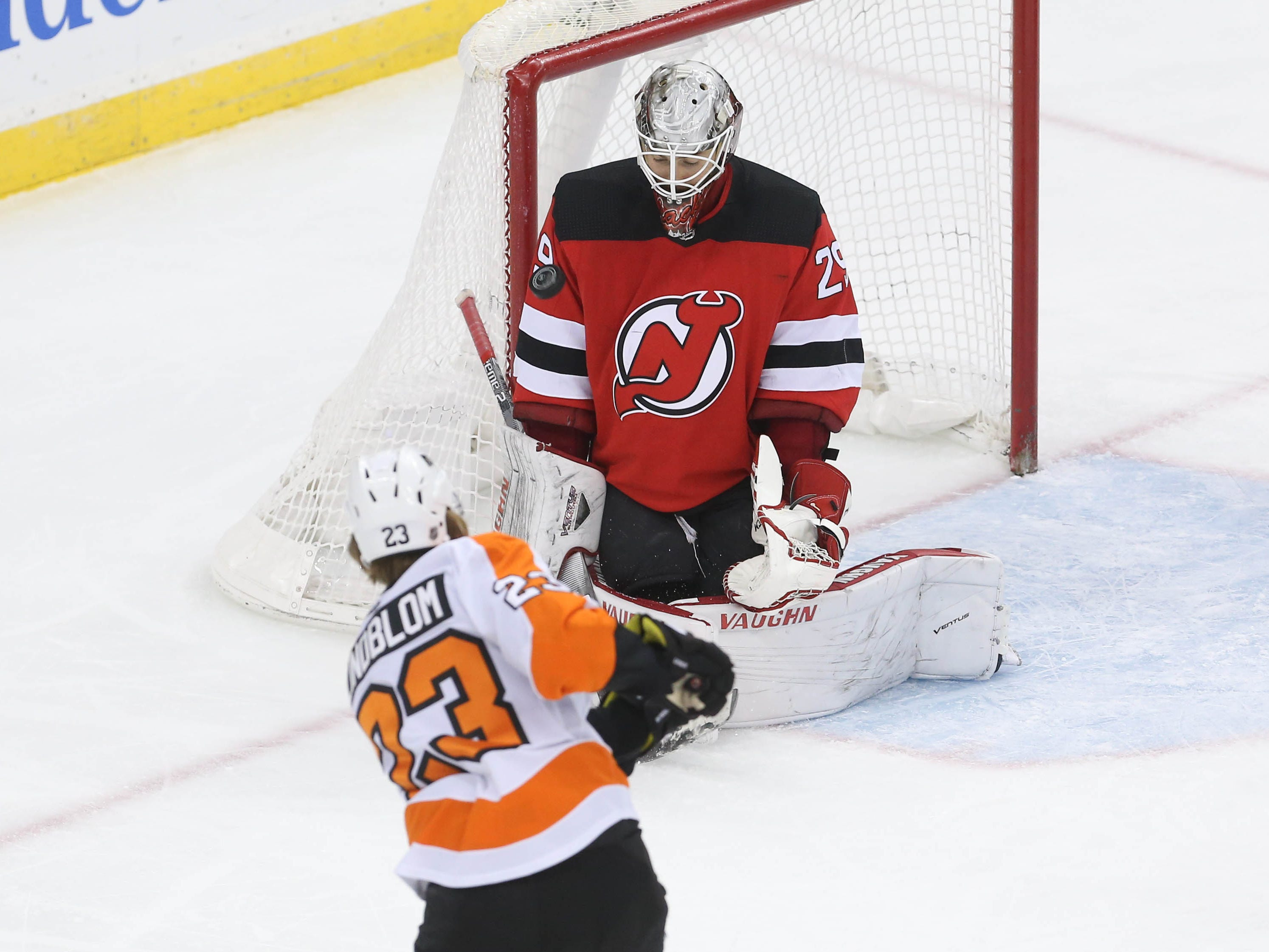 Jan 12, 2019; Newark, NJ, USA; New Jersey Devils goaltender Mackenzie Blackwood (29) makes a save on Philadelphia Flyers left wing Oskar Lindblom (23) during the third period at Prudential Center