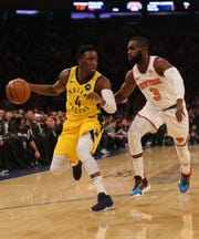 Jan 11, 2019; New York, NY, USA; Indiana Pacers guard Victor Oladipo (4) controls the ball against New York Knicks guard Tim Hardaway Jr. (3) during the first quarter at Madison Square Garden.