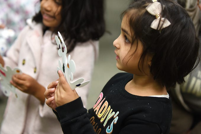 Children make a snowstorm in a bottle as part of the STEM Saturday series at East Rutherford Memorial Library on Saturday January 12, 2019. Areebah Jaweid, 4 shows off a snowflake she decorated.