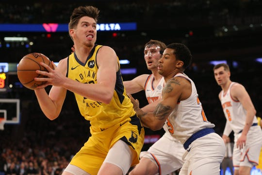 Jan 11, 2019; New York, NY, USA; Indiana Pacers forward TJ Leaf (22) controls the ball against New York Knicks guard Trey Burke (23) during the second quarter at Madison Square Garden.