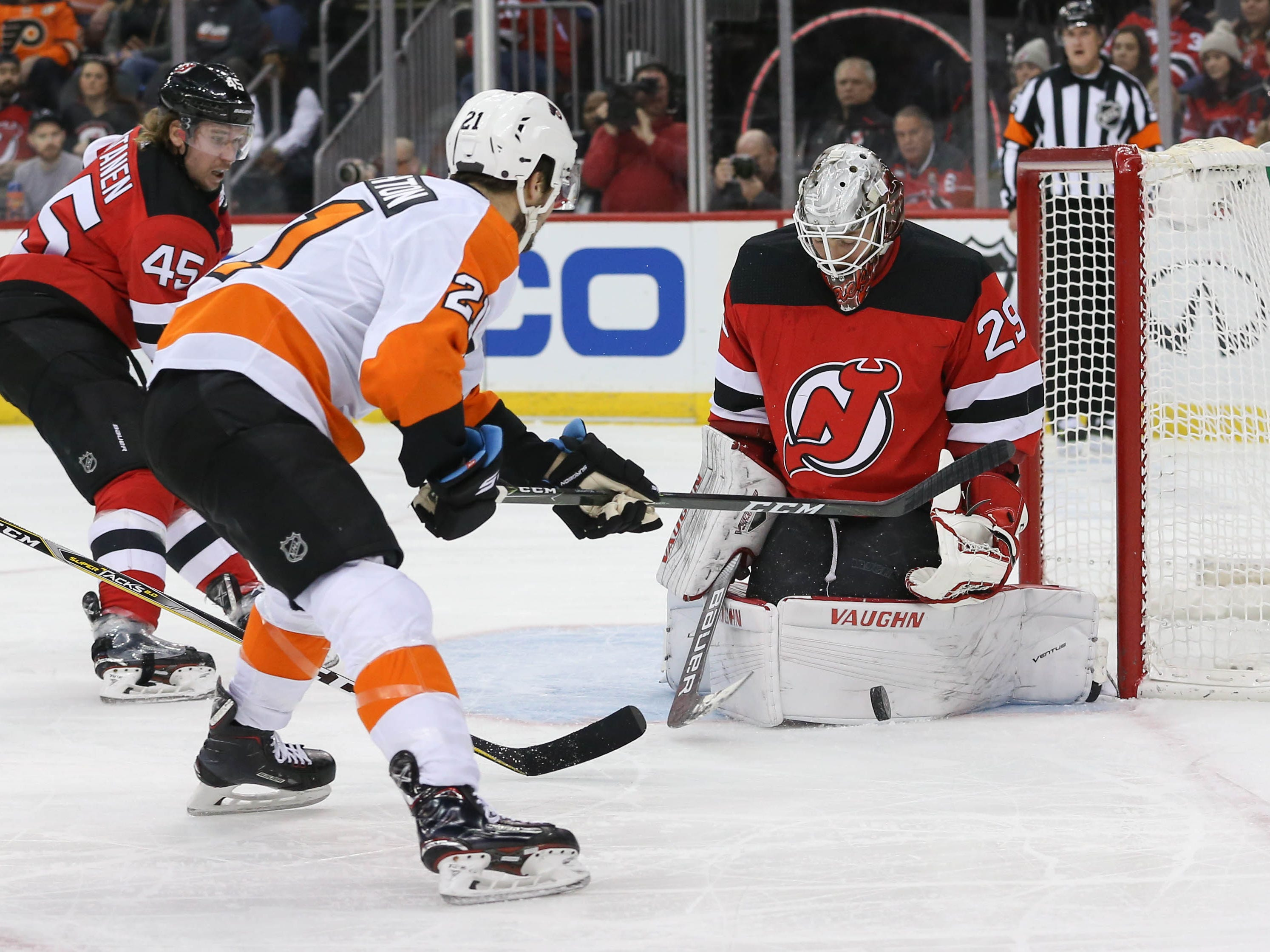 Jan 12, 2019; Newark, NJ, USA; New Jersey Devils goaltender Mackenzie Blackwood (29) makes a save on Philadelphia Flyers center Scott Laughton (21) during the first period at Prudential Center.