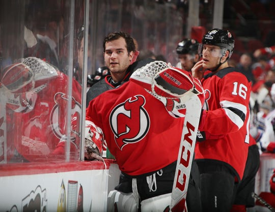 NEWARK, NEW JERSEY - SEPTEMBER 17: Cam Johnson #33 of the New Jersey Devils takes a break against the New York Rangers during a preseason game at the Prudential Center on September 17, 2018 in Newark, New Jersey.