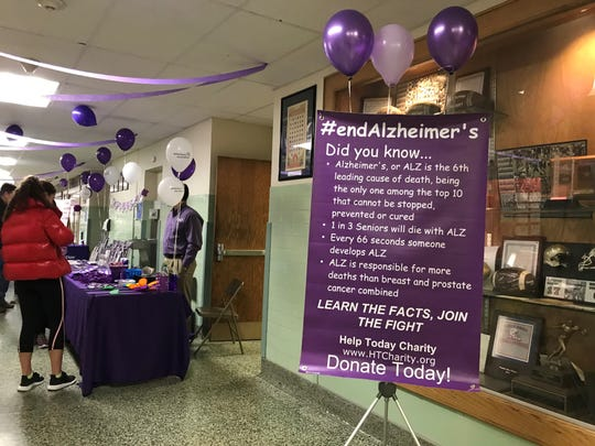 A sign about Alzheimer's greets attendees of a basketball tournament held Saturday, January, 12, 2019 to raise awareness and funds for Alzheimer's.