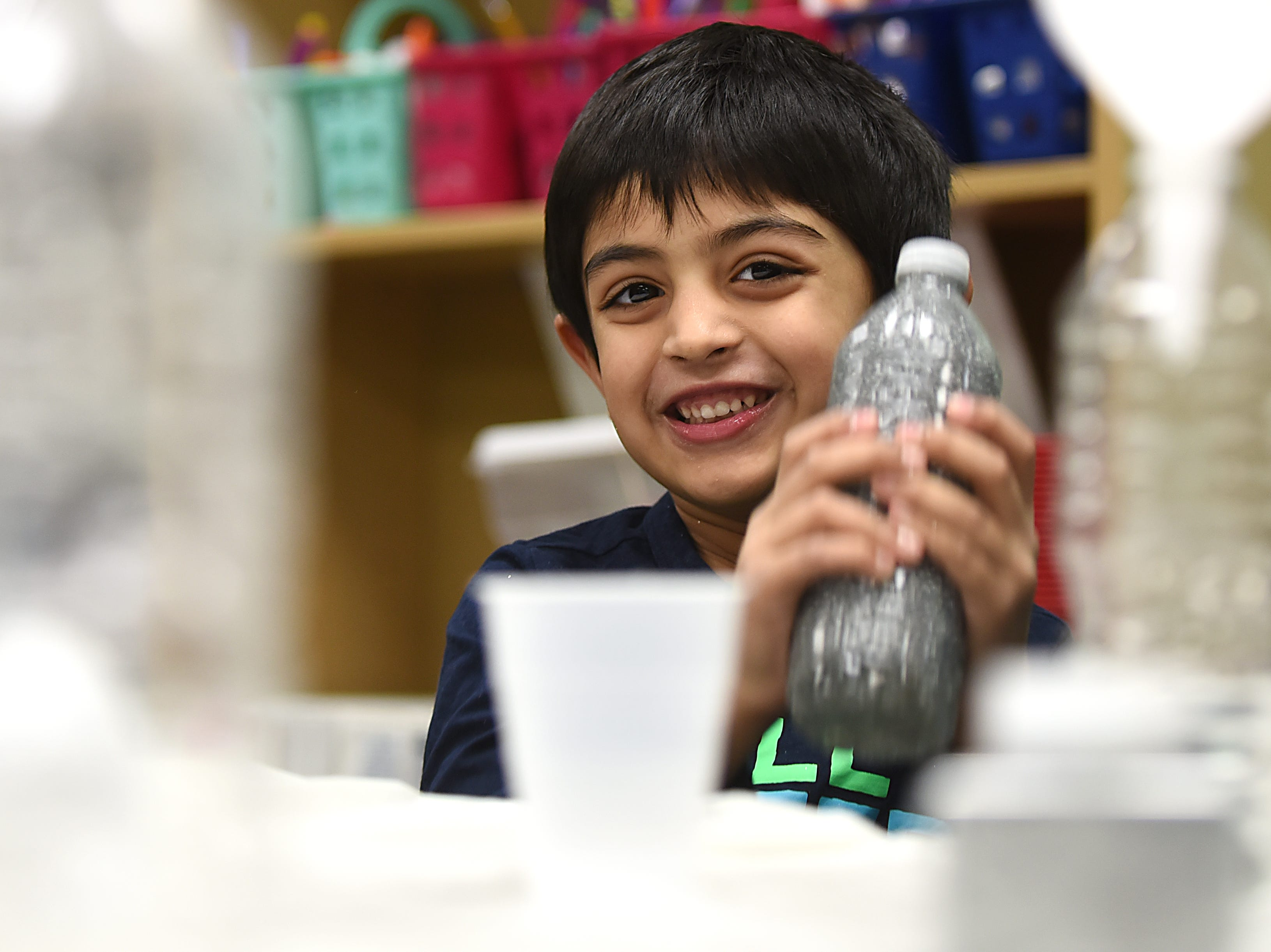 Rayoyau Jaweid, 5 smiles as he shakes his snowstorm in a bottle. This is part of the STEM Saturday series at East Rutherford Memorial Library on Saturday January 12, 2019.