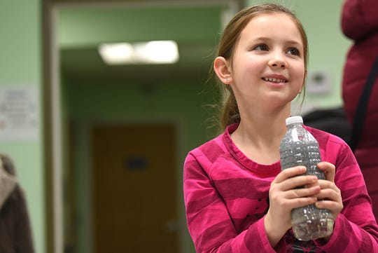 Julia Mazur, 7 smiles as she shakes her snowstorm in a bottle. This is part of the STEM Saturday series at East Rutherford Memorial Library on Saturday January 12, 2019.