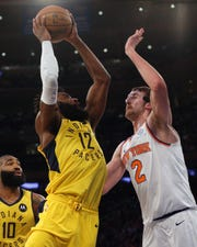 Jan 11, 2019; New York, NY, USA; Indiana Pacers guard Tyreke Evans (12) shoots against New York Knicks forward Luke Kornet (2) during the second quarter at Madison Square Garden.